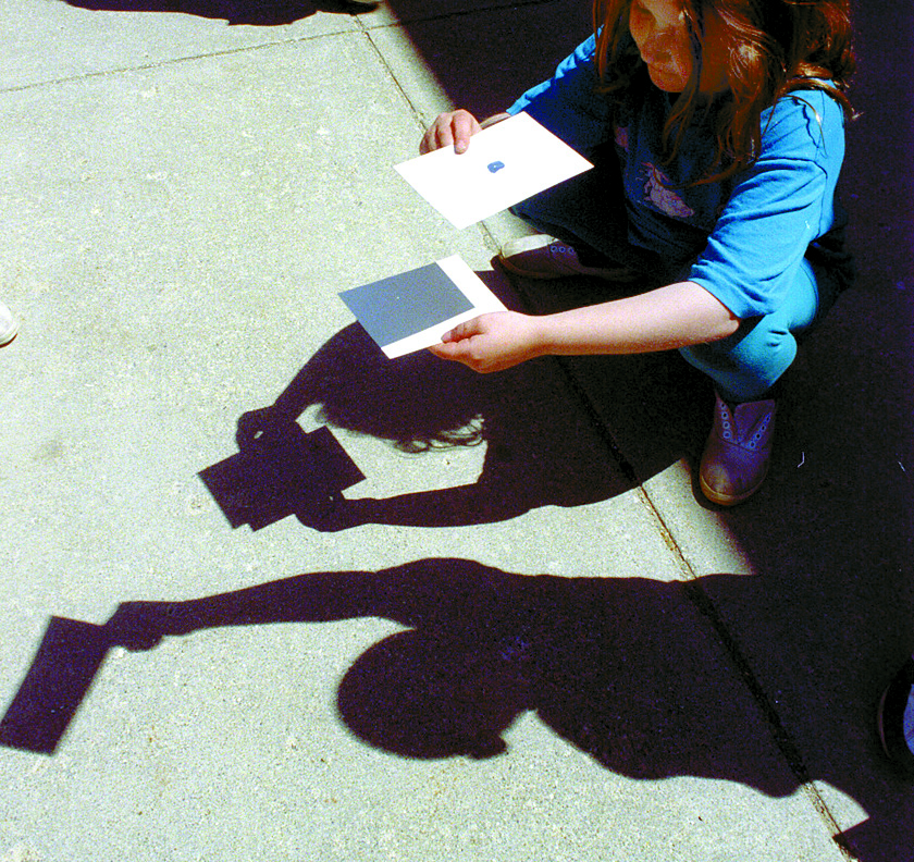 Emily Hann Projects Solar Eclipse Through Hole In Paper, May 10, 1994 image