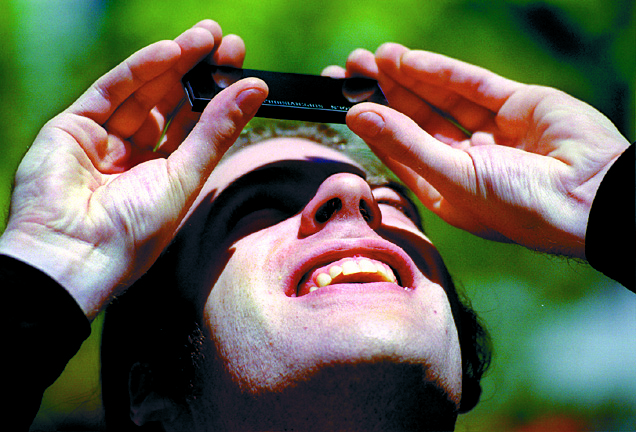 Jim Dann Uses Pieces Of Glass To View The Solar Eclipse, May 10, 1994 image