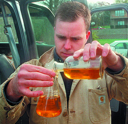 Water quality technician Chris Cieciek, of Limno-Tech Inc., tests the Sister Lakes image