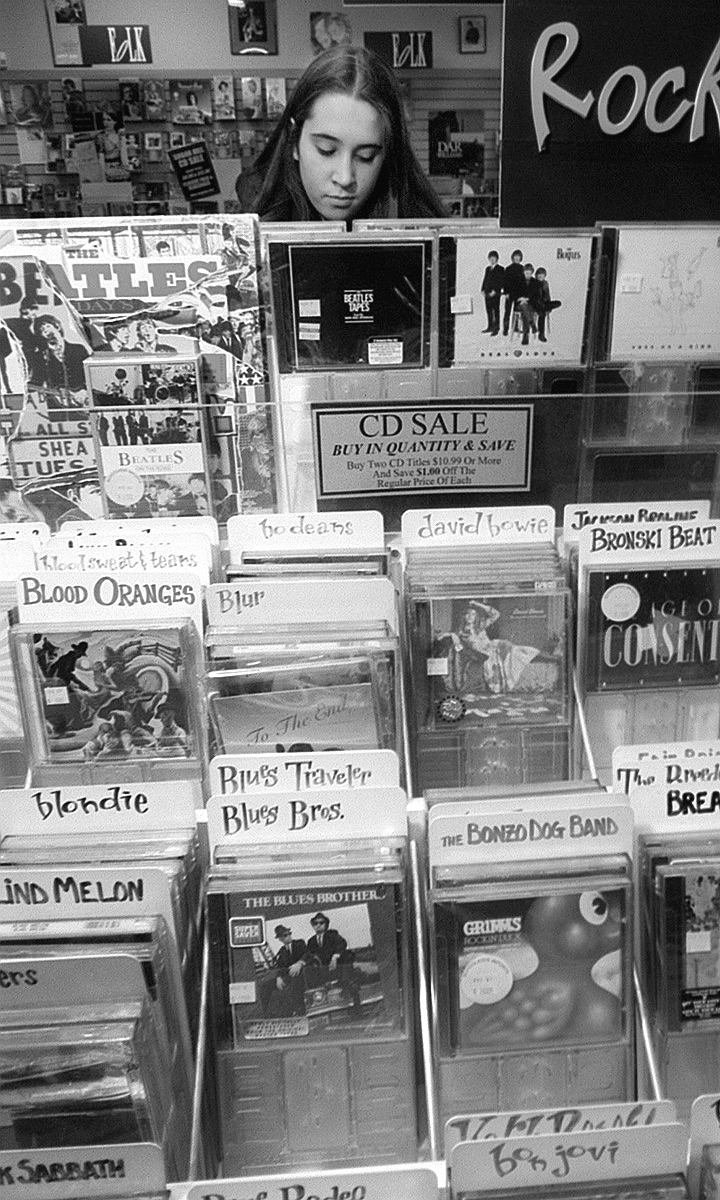 Sara Chakel Looks At CDs At Schoolkids' Records, May 1, 1996 image