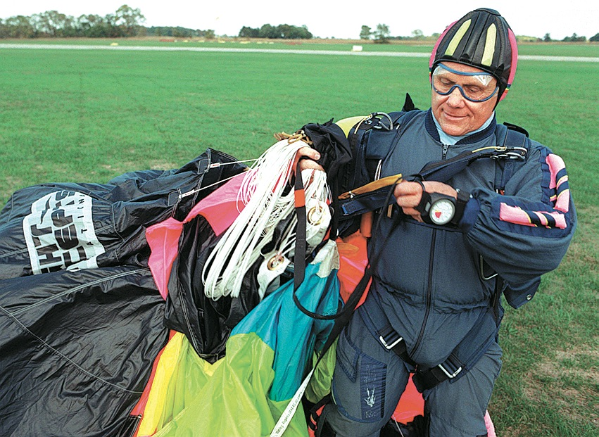 Brownlee gathers his parachute at Tecumseh Airport, October 1996 image