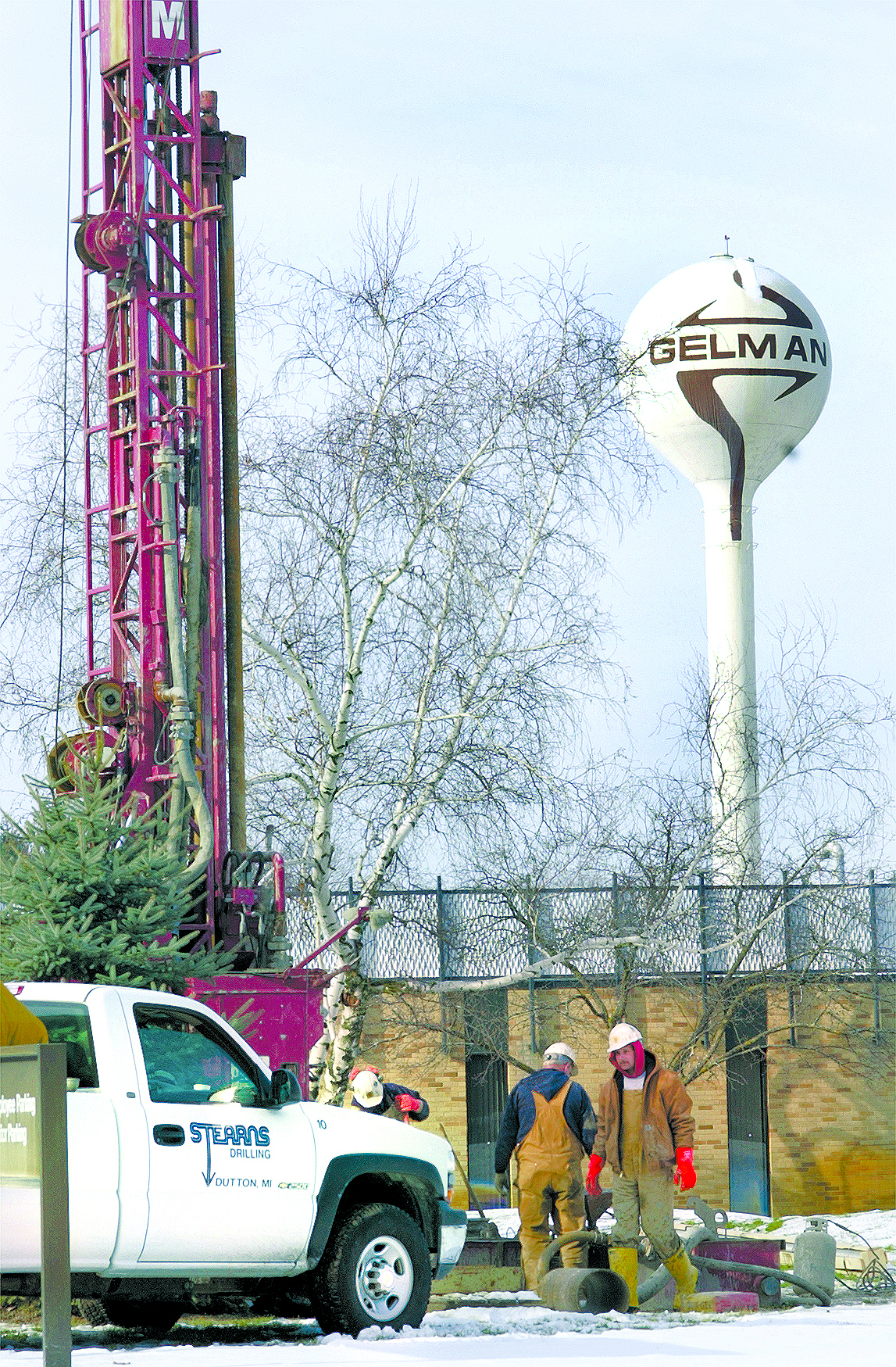 Workers drill well at Pall Life Sciences plant, January 2002 image