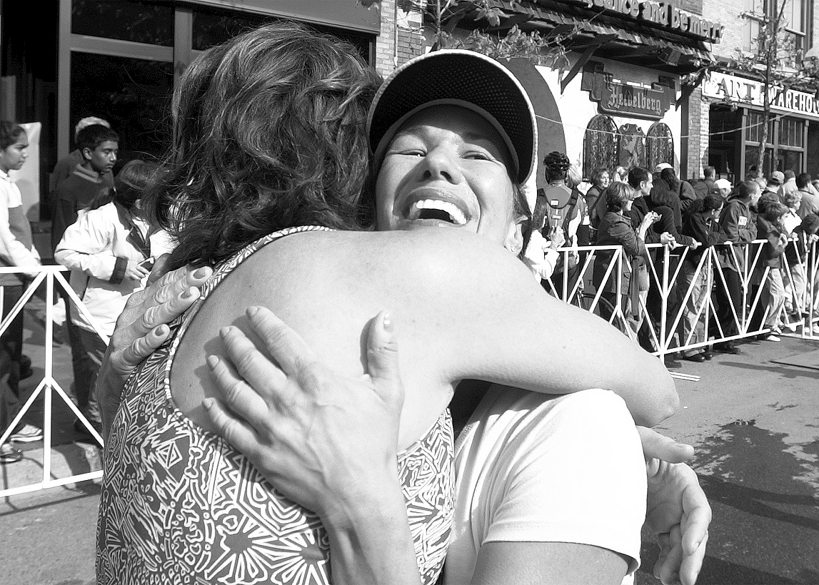 Suzanne Lotz Gets A Hug After Finishing The Dexter-Ann Arbor Run, June 1, 2003 image