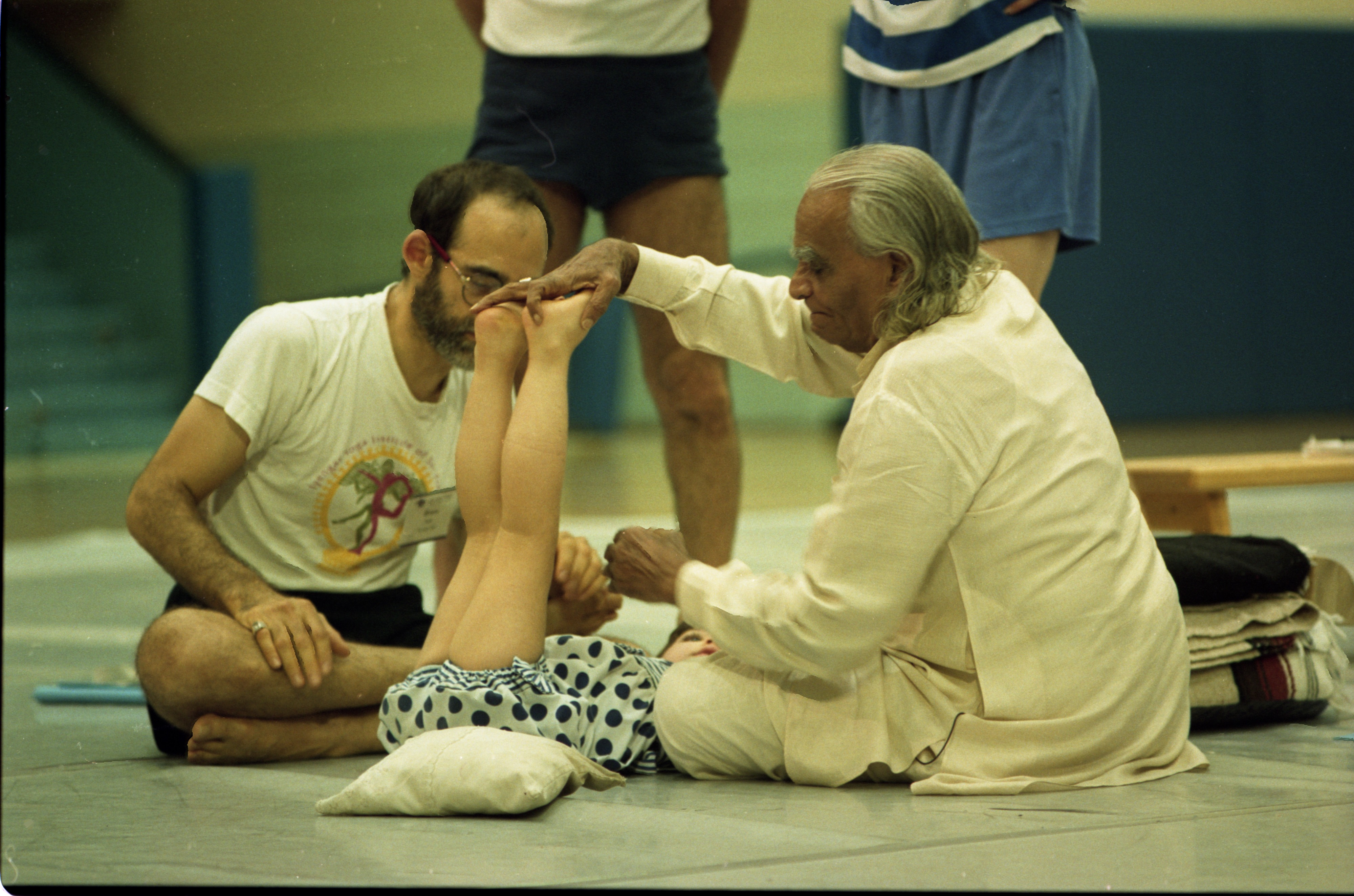 B.K.S. Iyengar Helps Child In Yoga Class, August 12, 1993 image