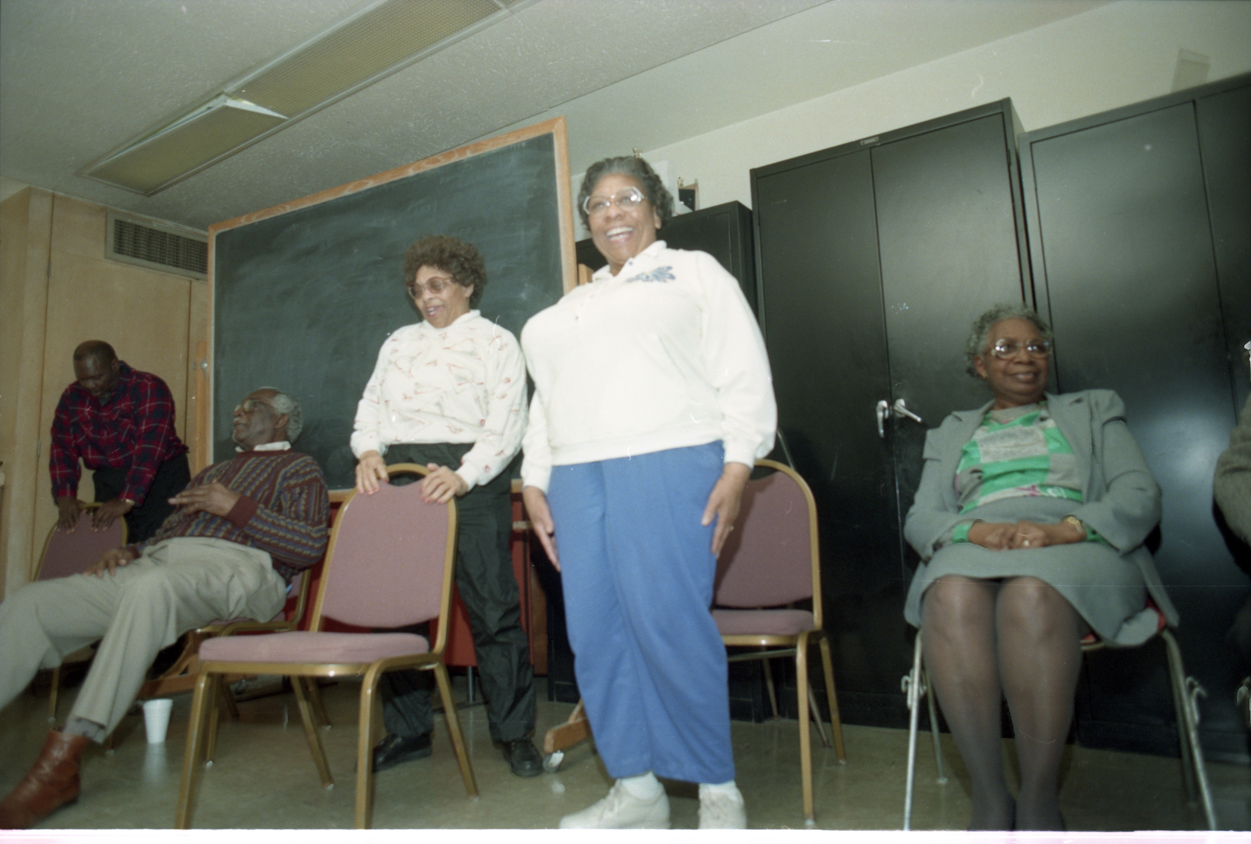 Senior Adults At The Ann Arbor Community Center For Chair Exercise Class Take A Break,  March 11, 1995 image