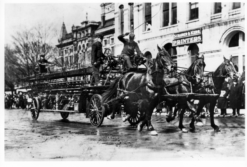 A Fire Department hook-and-ladder, ca. 1910 image