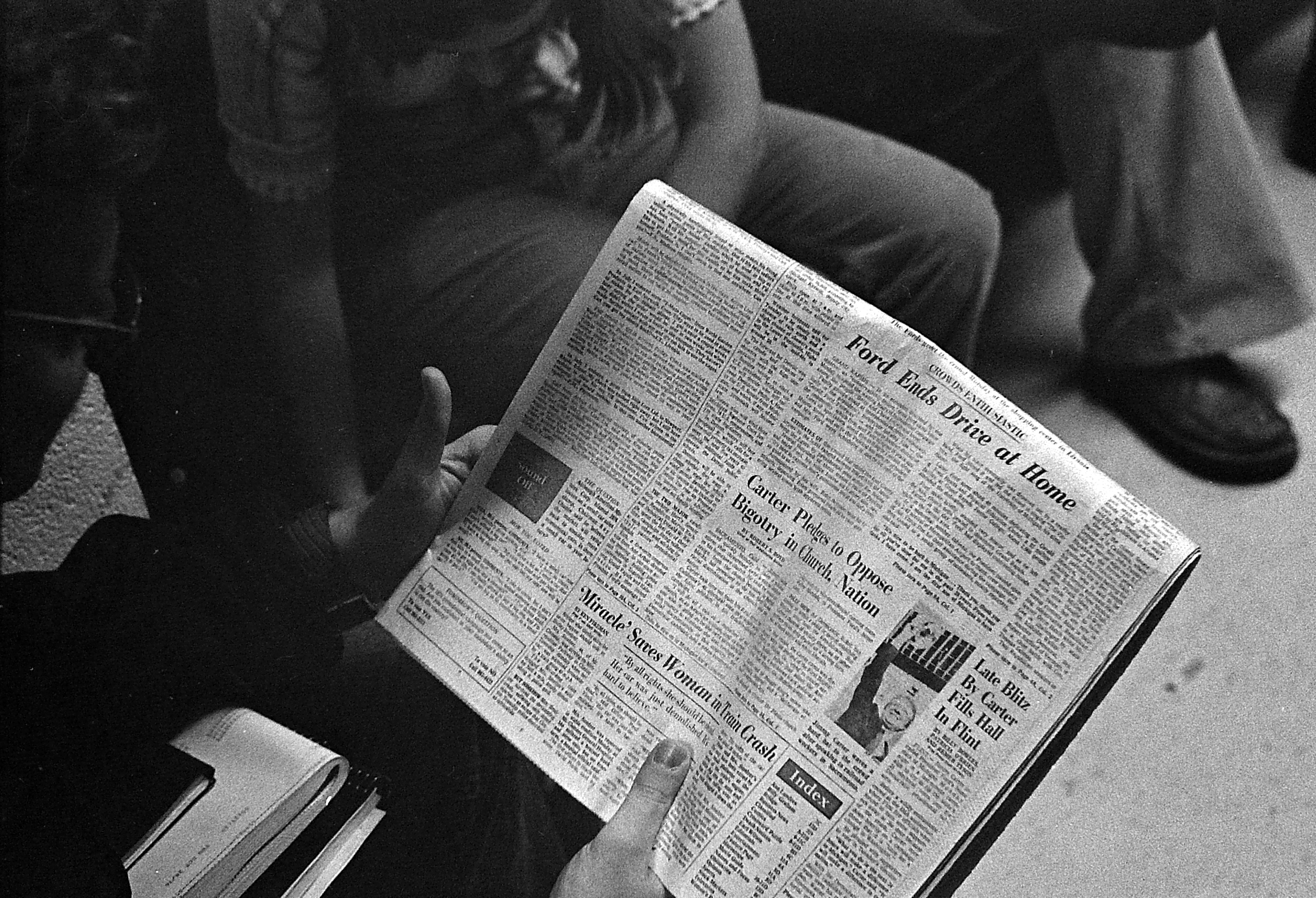 Reading Newspaper While Waiting To Vote, November 1976 image