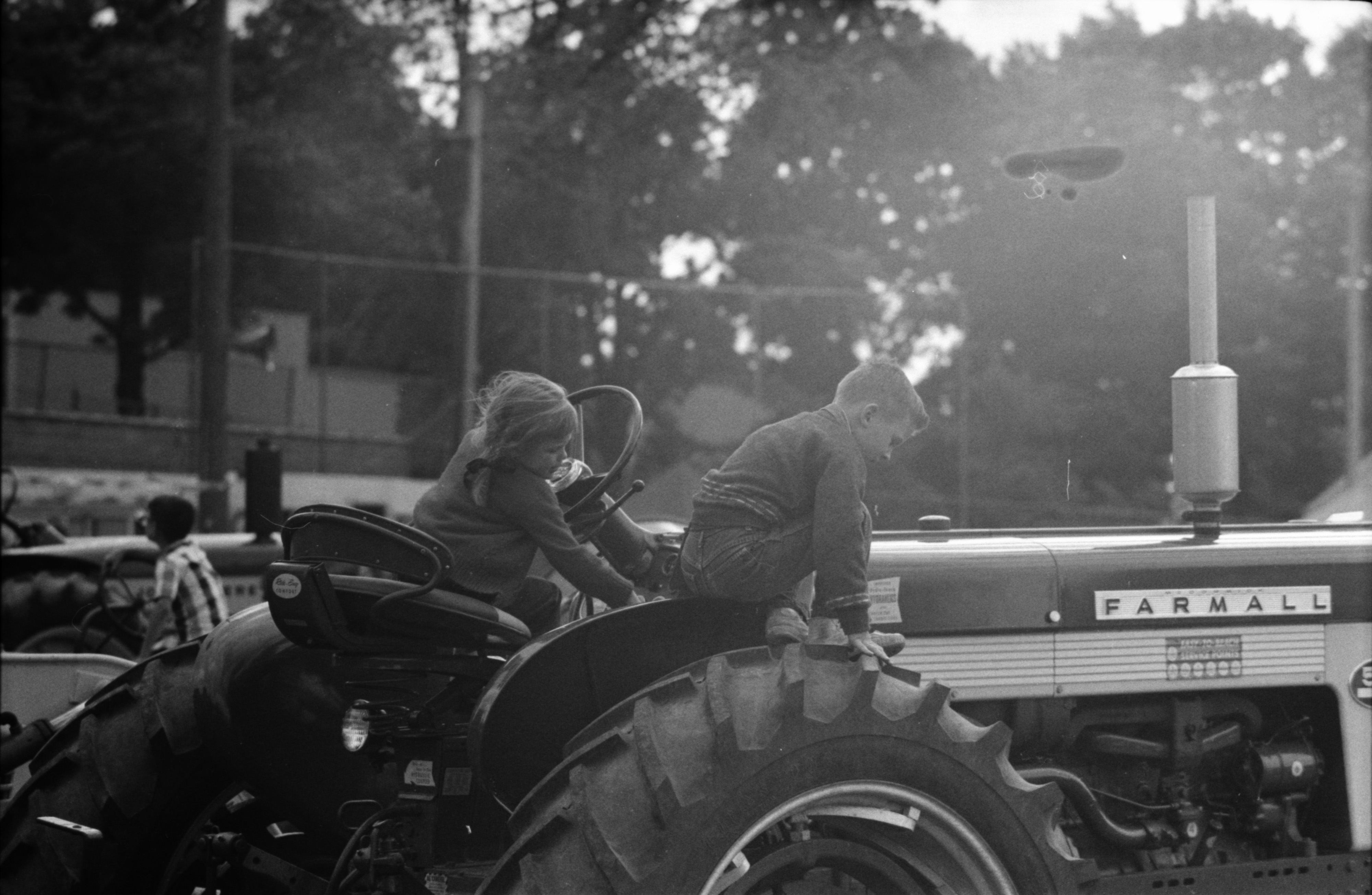Boy and Girl on a Farmall Tractor at the Saline Fair image