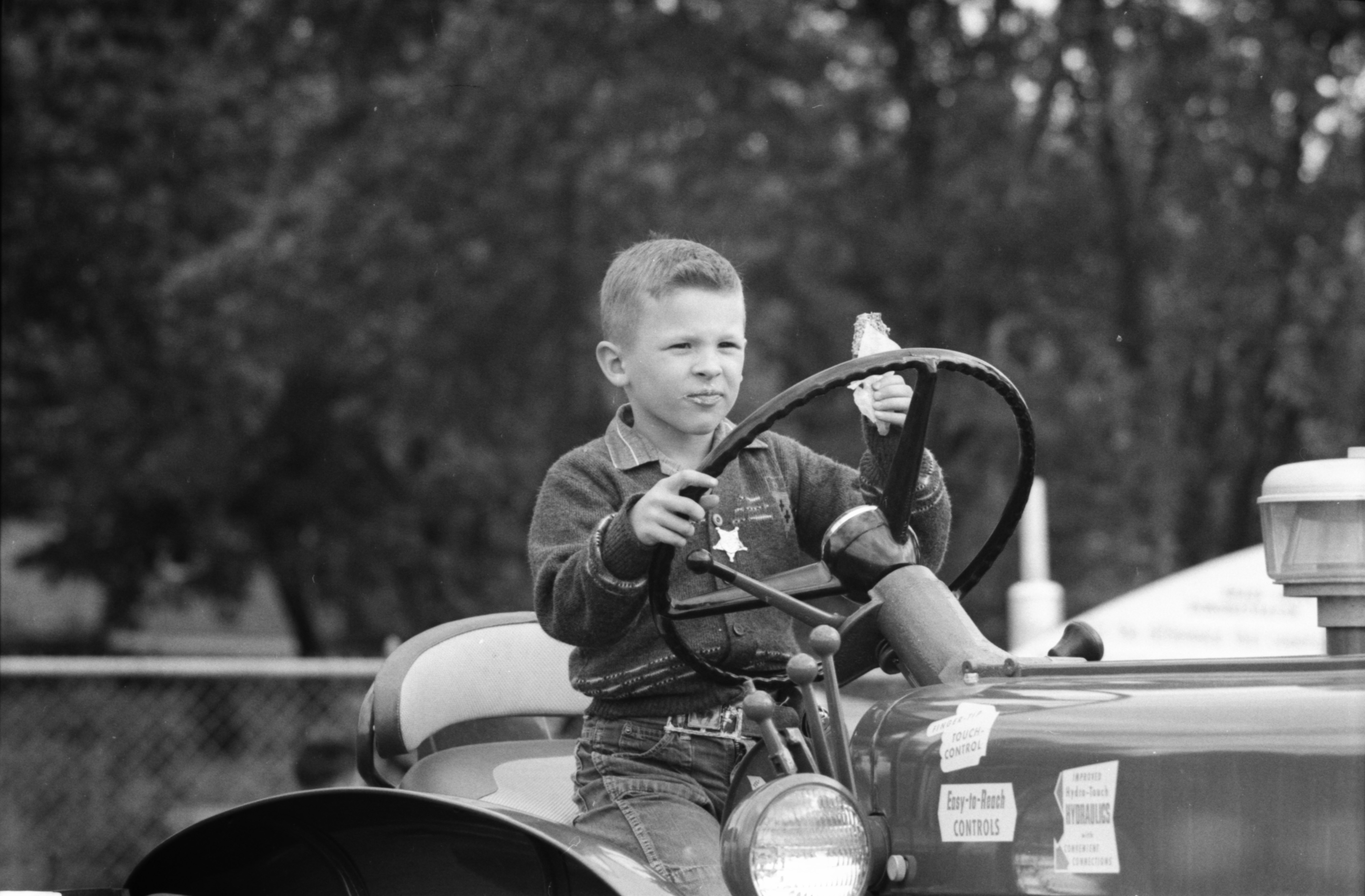 Boy on a Tractor at the Saline Fair image