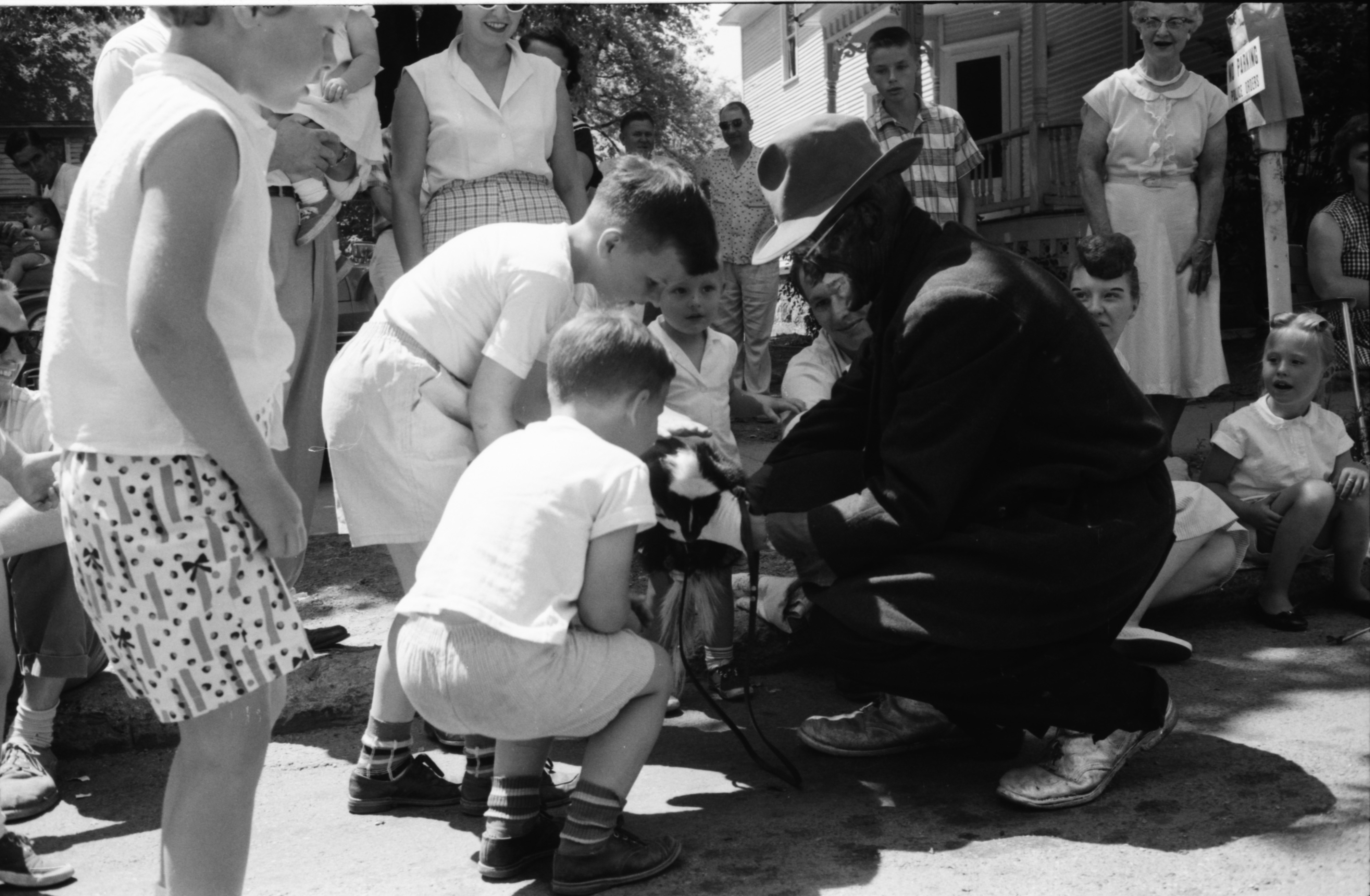 Costumed Man With Skunk Surrounded By Kids At The Ypsilanti Fourth Of July Parade, July 1959 image