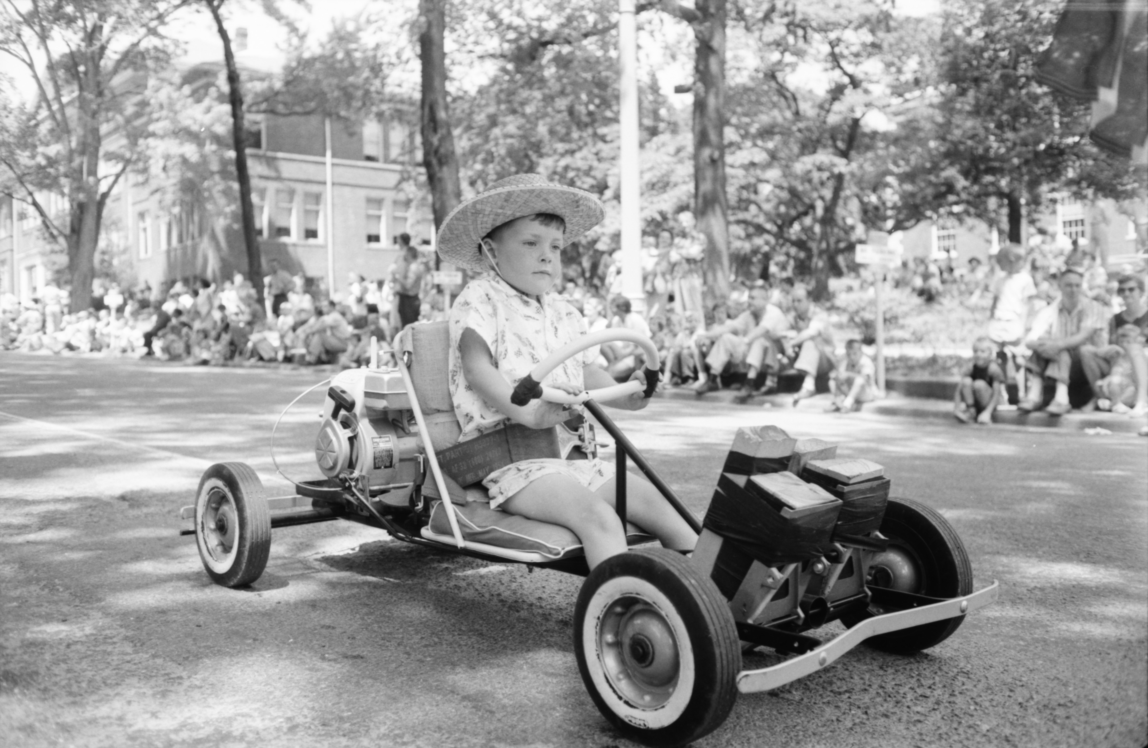 Little Boy 'Drives' His Vehicle In The Ypsilanti Fourth Of July Parade, July 1959 image
