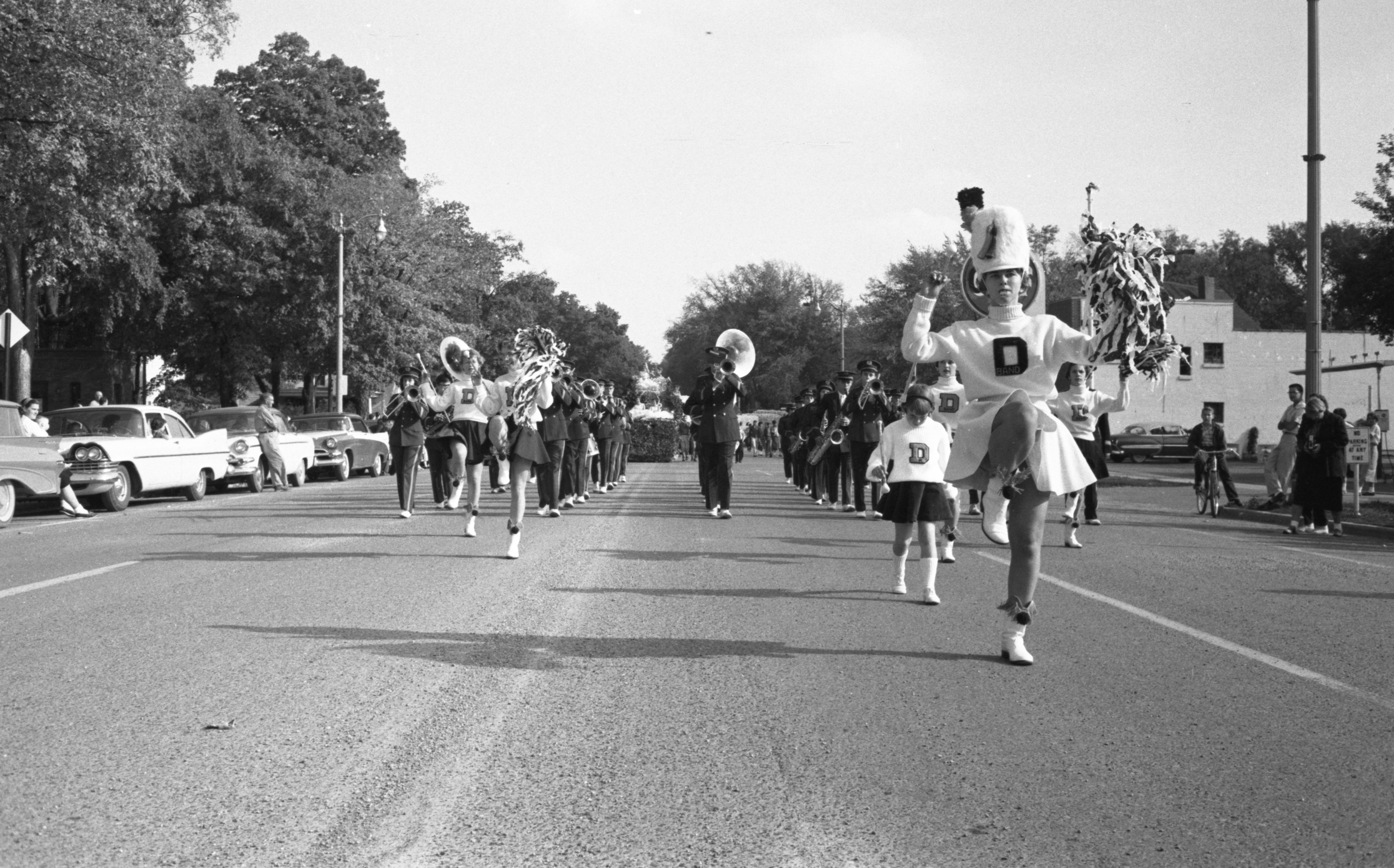 Marching Band Members In The Dexter High School Homecoming Parade, October 1959 image