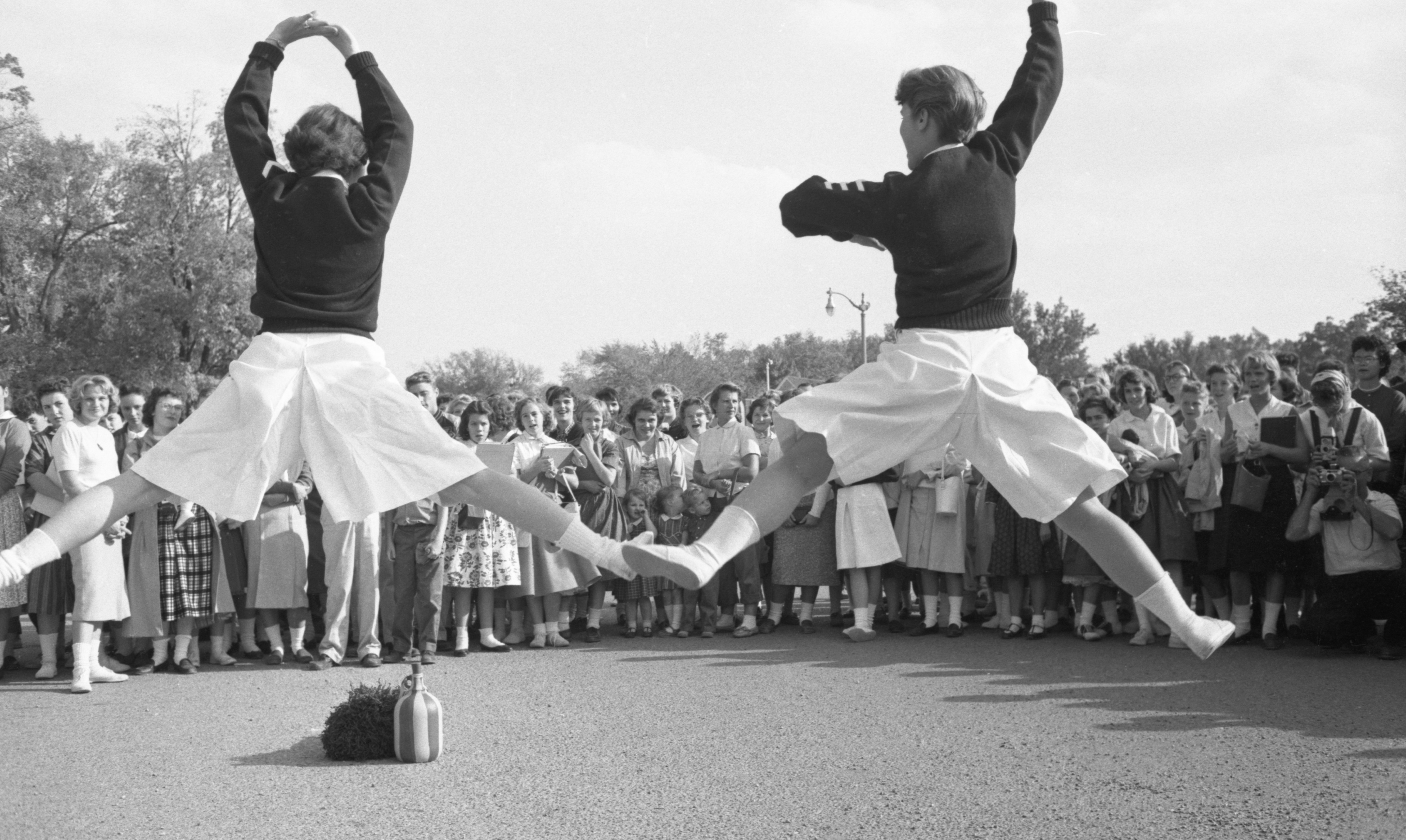 Cheerleaders Perform For A Crowd At The Dexter High School Homecoming Parade, October 1959 image