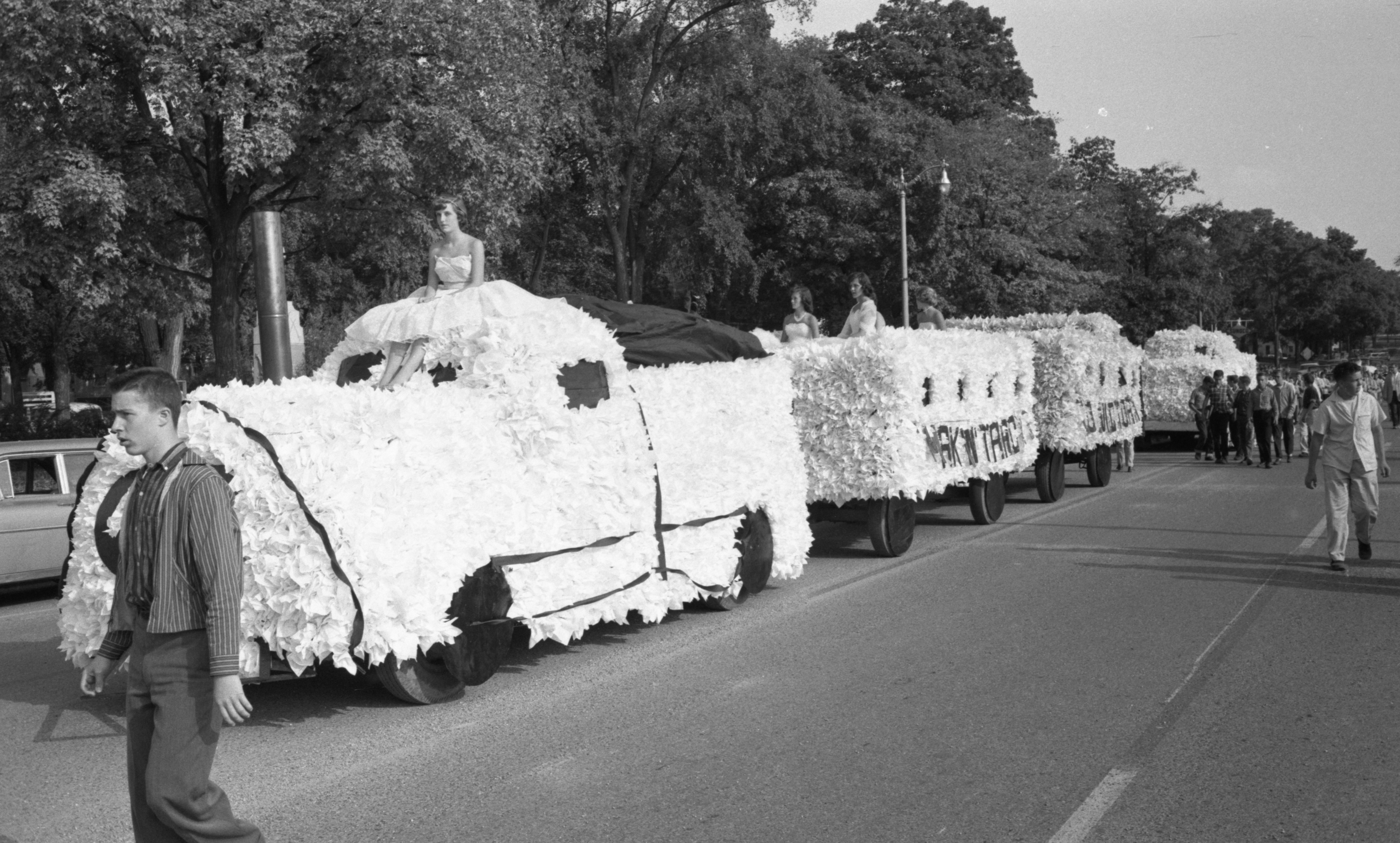 Floats Roll Into Downtown Dexter In The High School Homecoming Parade, October 1959 image