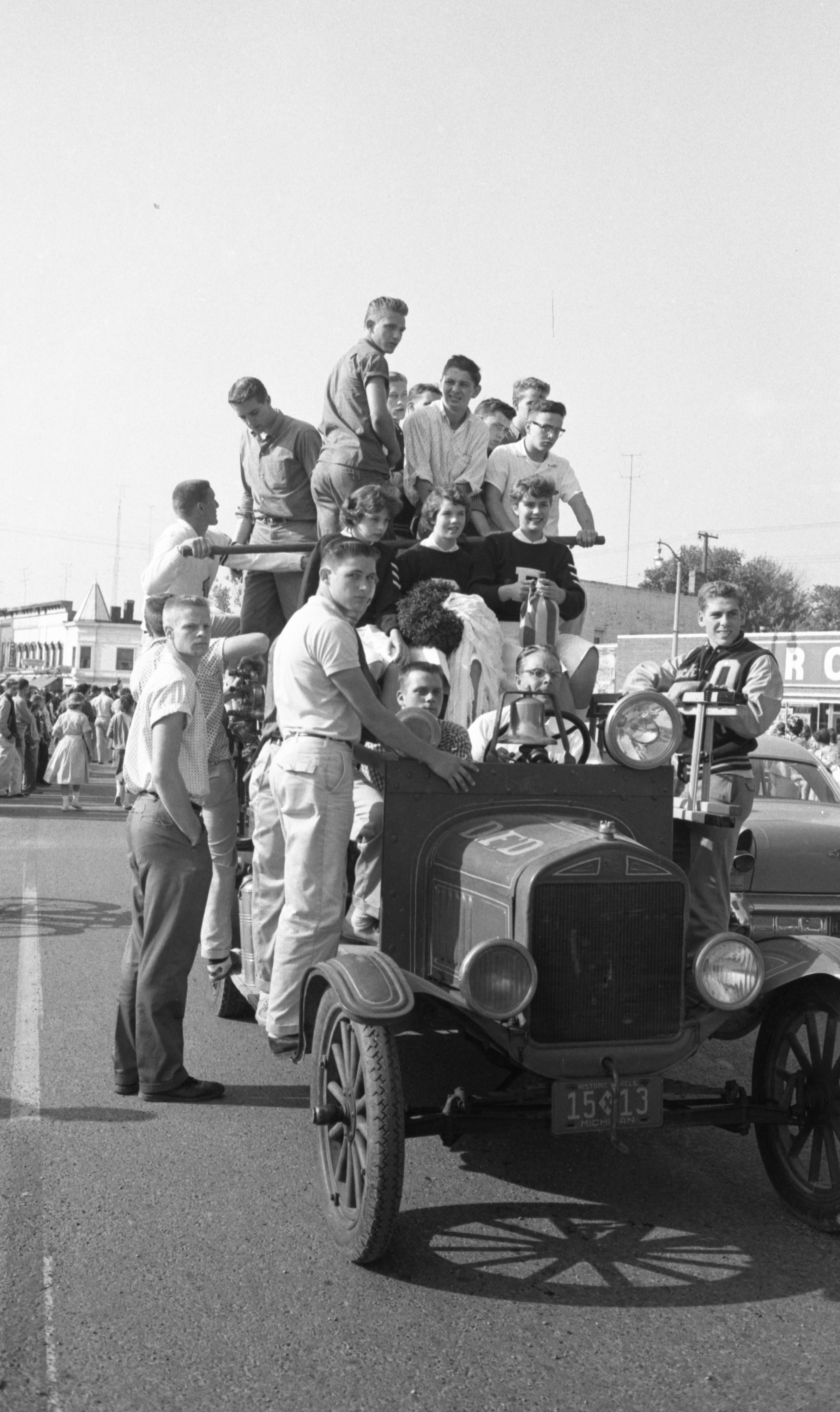 Dexter Students Ride An Old Fire Truck In The Homecoming Parade, October 1959 image