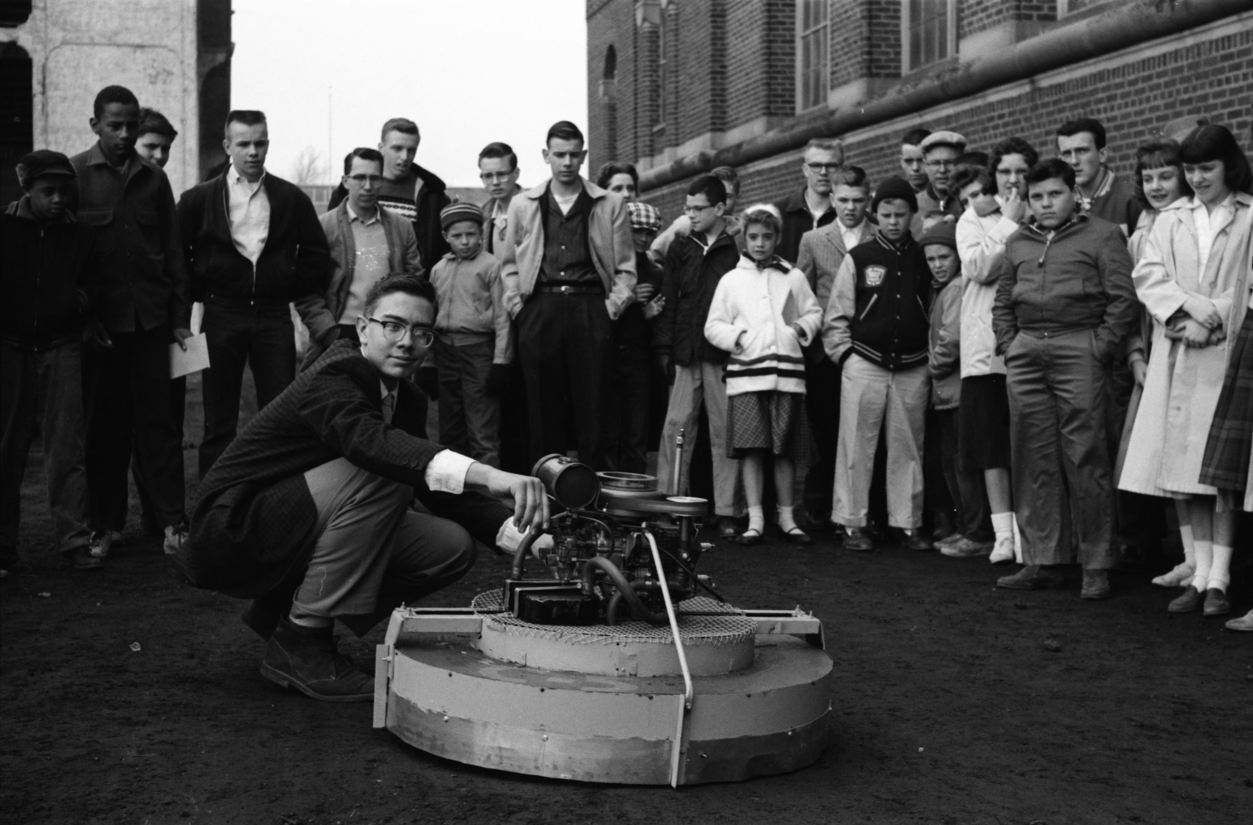 Don Cramer, of Ypsilanti, with his winning wheelless transportation device, at the Science Fair, April 1960 image
