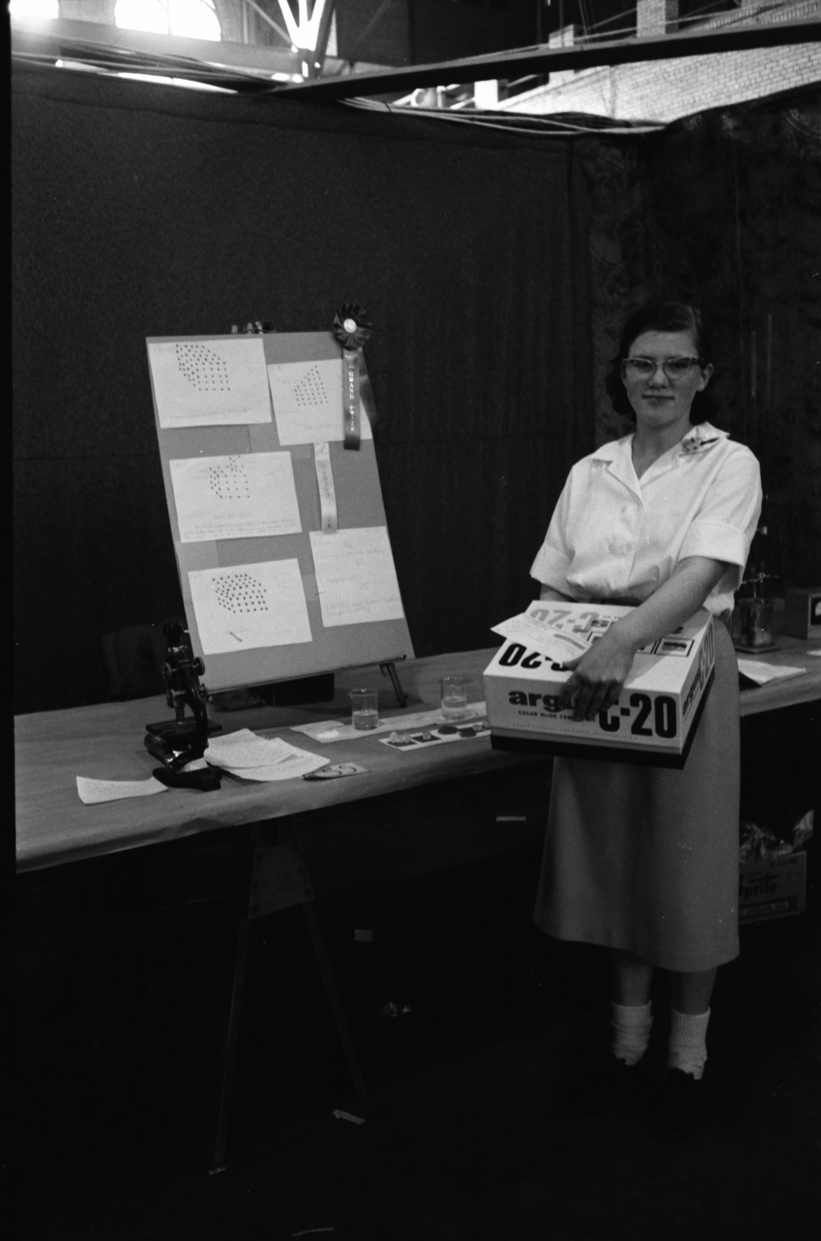 Mary Ann Tiffany, of Ann Arbor High School, wins first place in the senior division at the Southeast Michigan Science Fair, April 1960 image