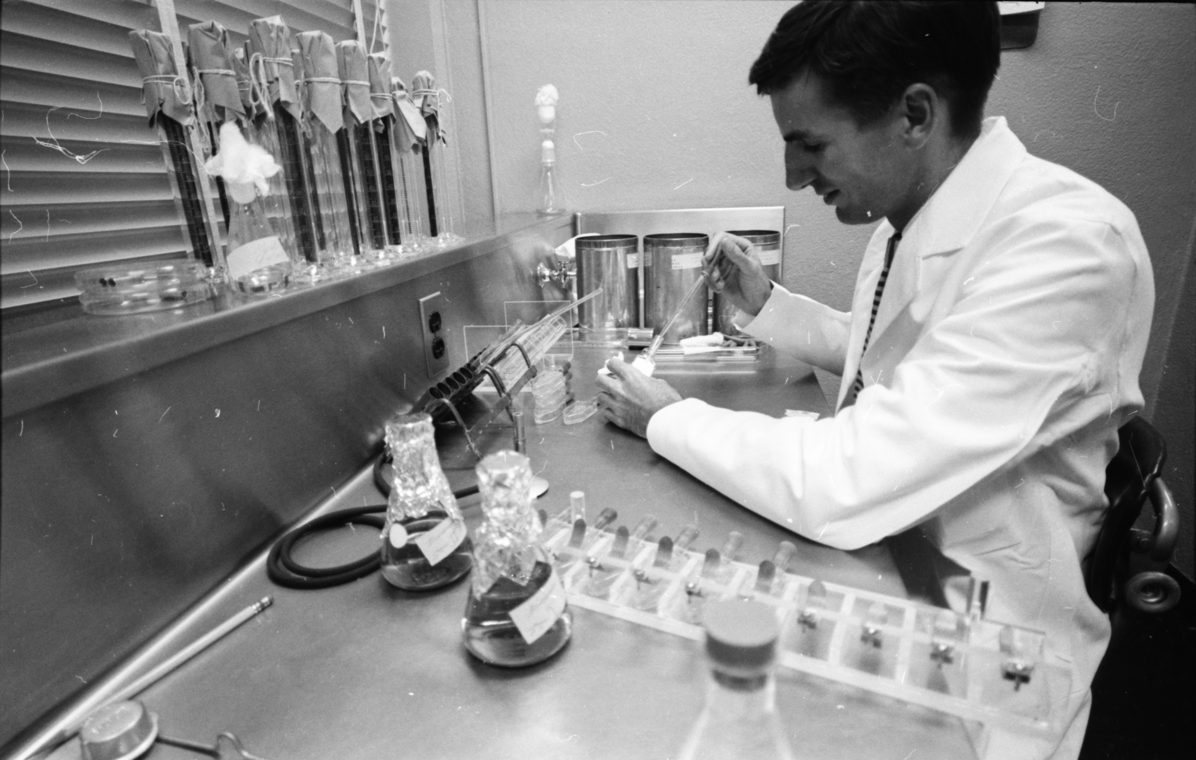 Dr. Harry C. Jordon, research associate, at the Phoenix Memorial Laboratory, August 1961 image