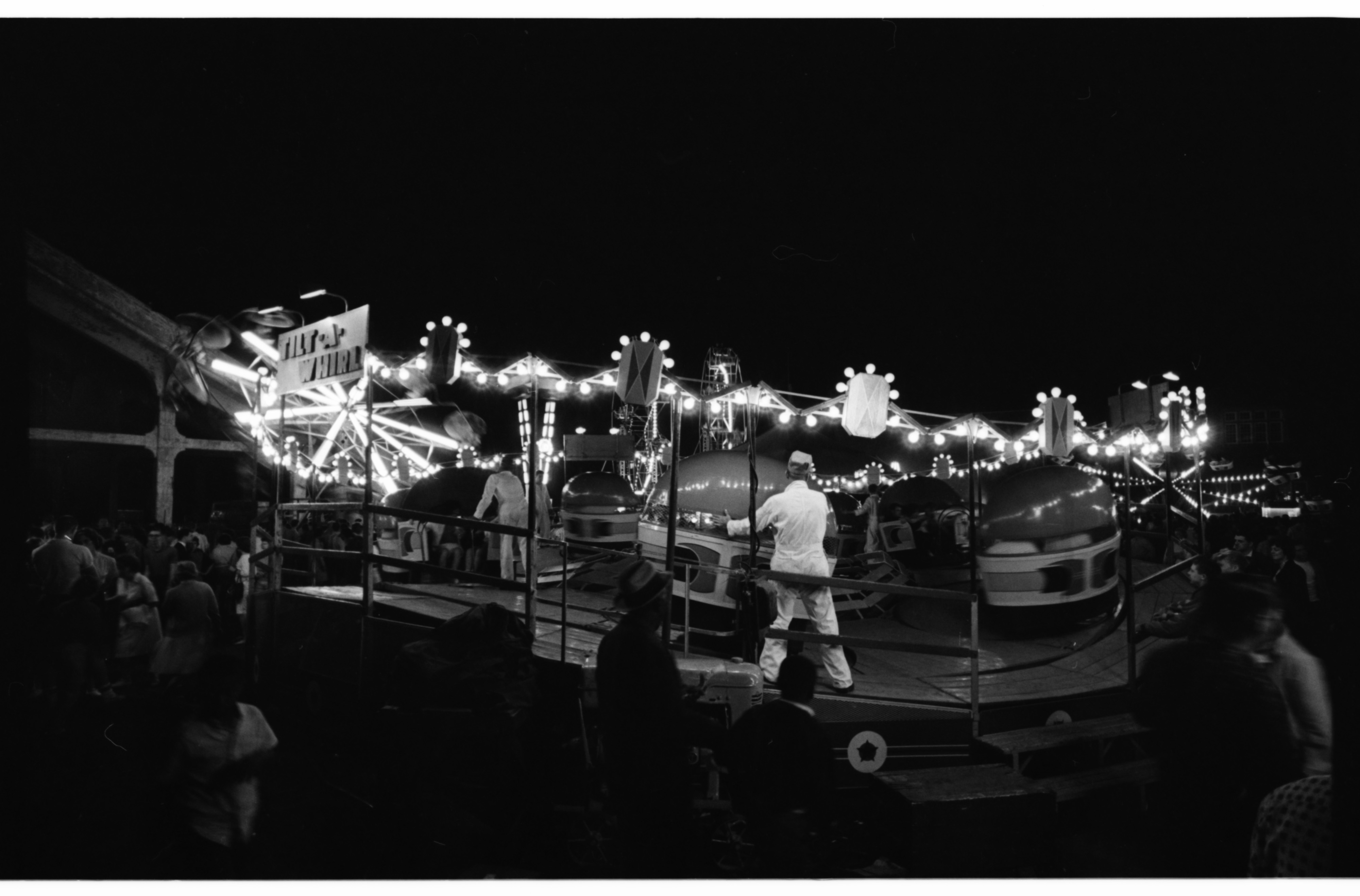 Tilt-a-Whirl at the Michigras Carnival near Yost Field House, April 1962 image