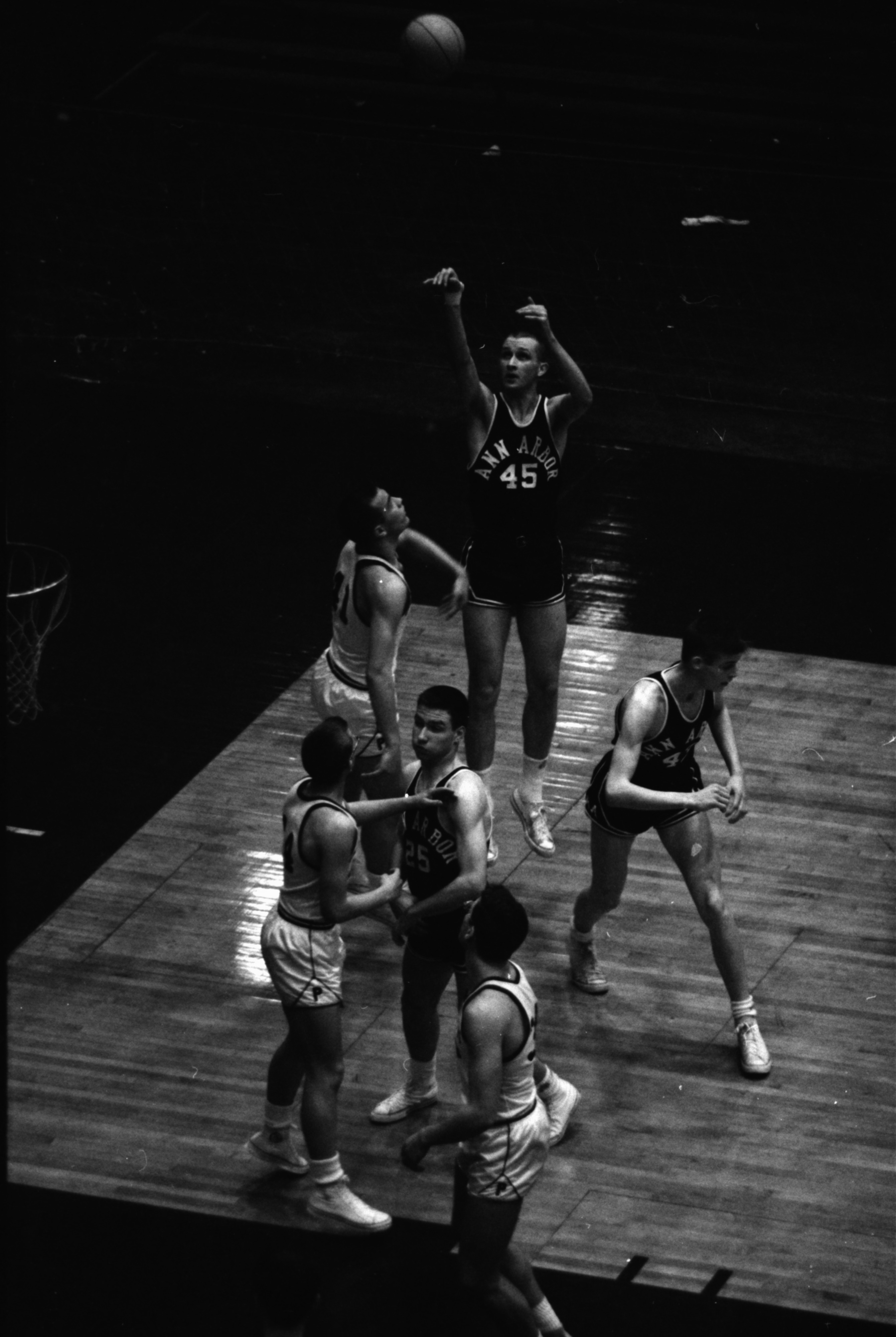 Basketball: Ann Arbor High School vs Plymouth, March 1963 image