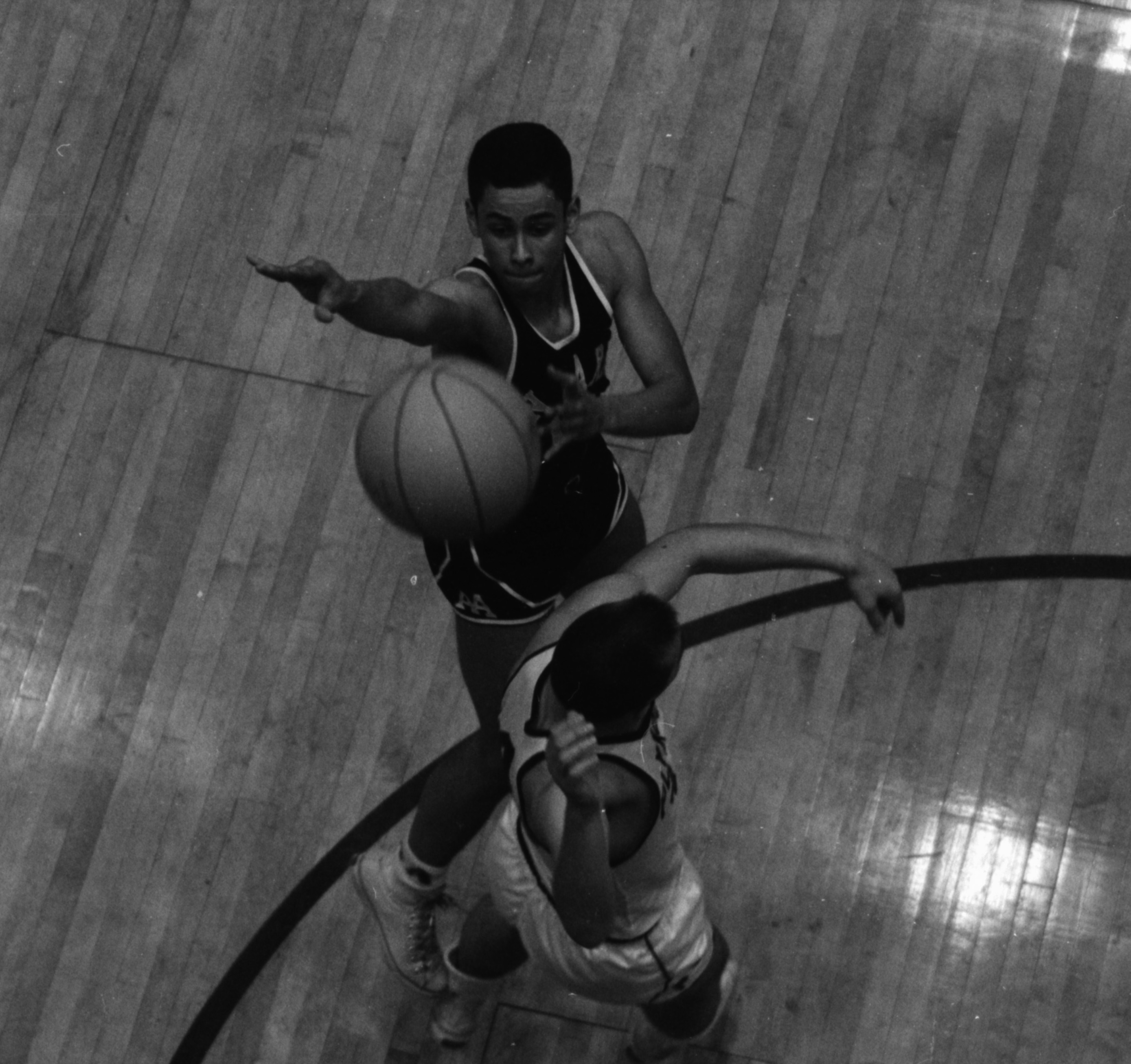 Ann Arbor High's Harold Simons shoots over Plymouth's Dick Egloff, March 7, 1963 image