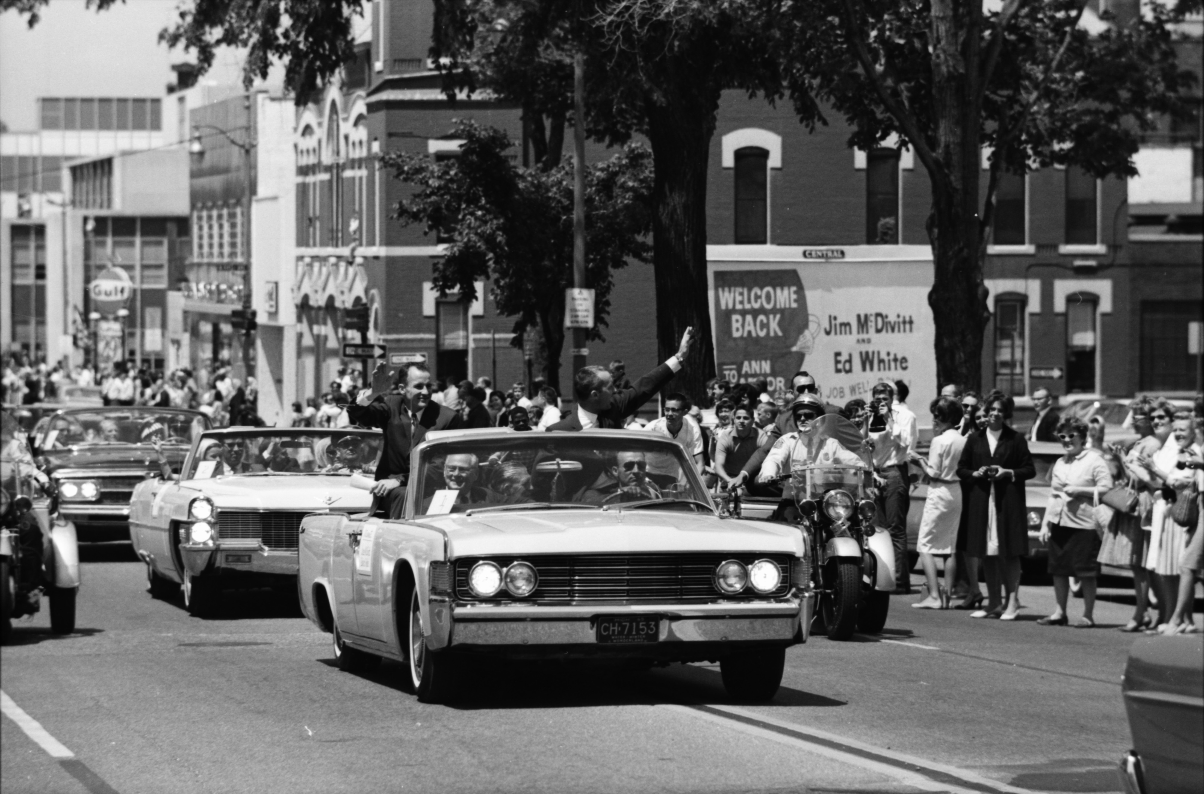 Astronauts James A. McDivitt and Edward H. White II in Motorcade through Ann Arbor, June 1965 image
