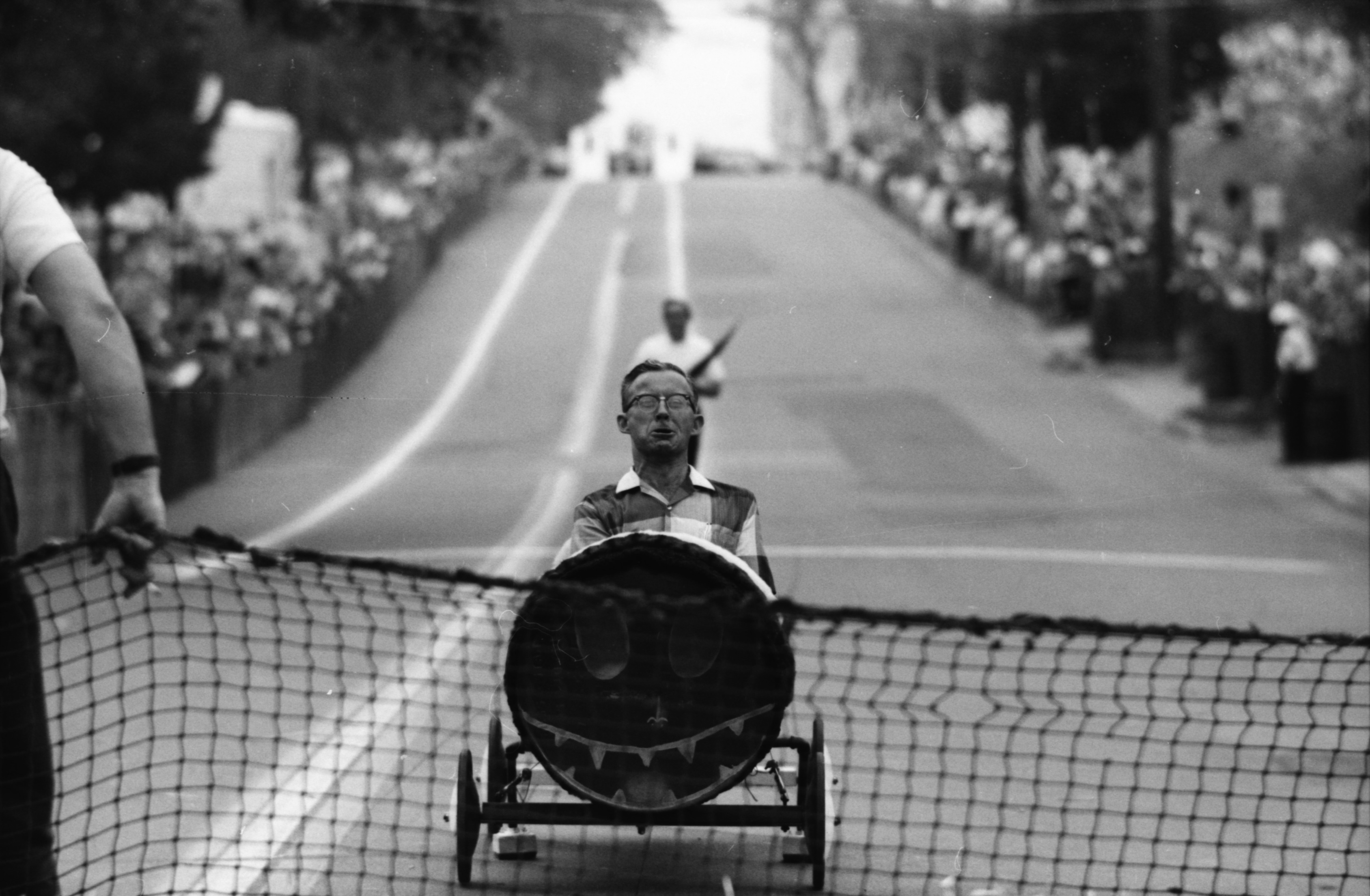 Ann Arbor Mayor Wendell Hulcher crosses the finish line in the Oil Can Derby, July 24, 1965	 image