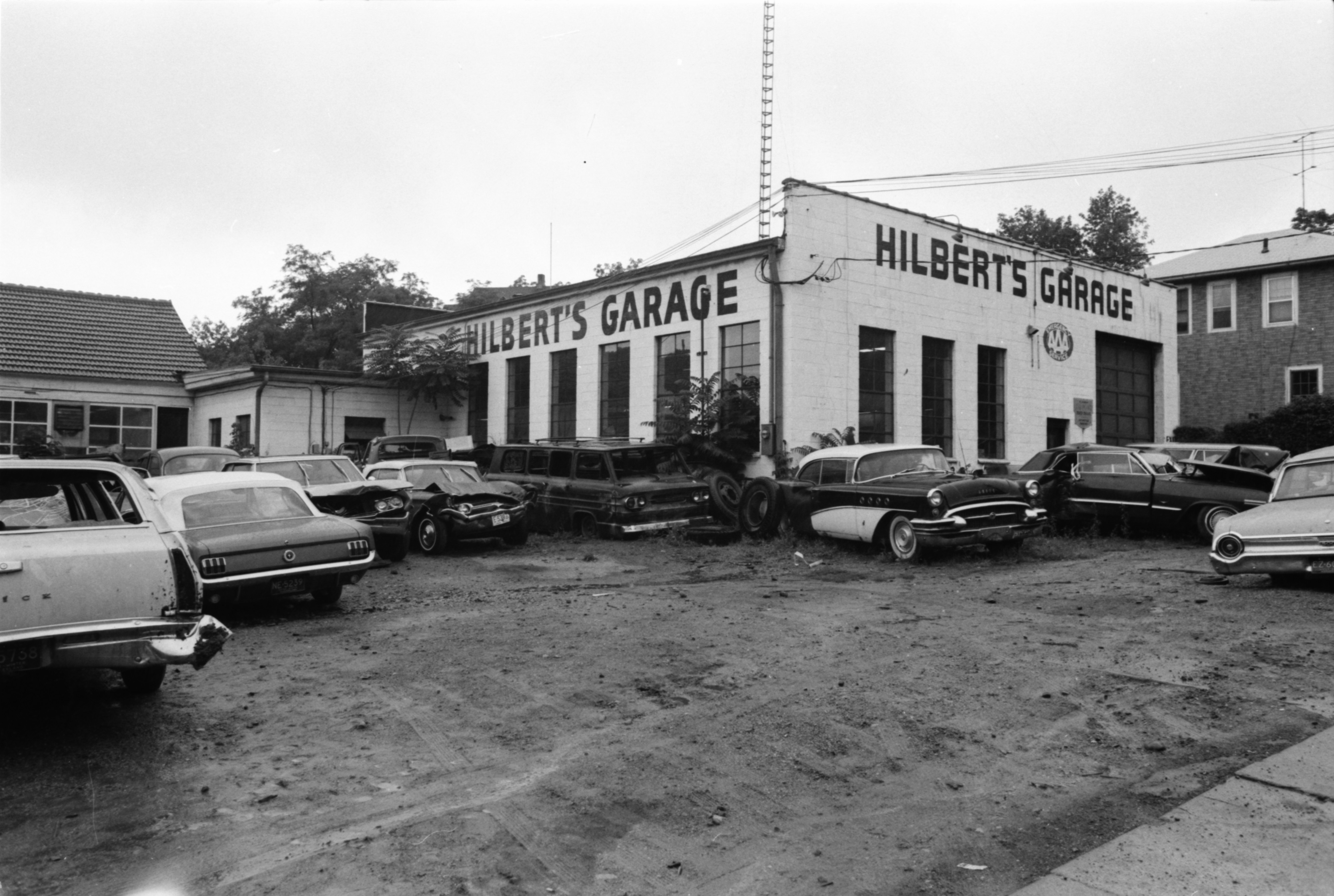 Wrecked Cars in front of Hilbert's Garage, August 1965 image