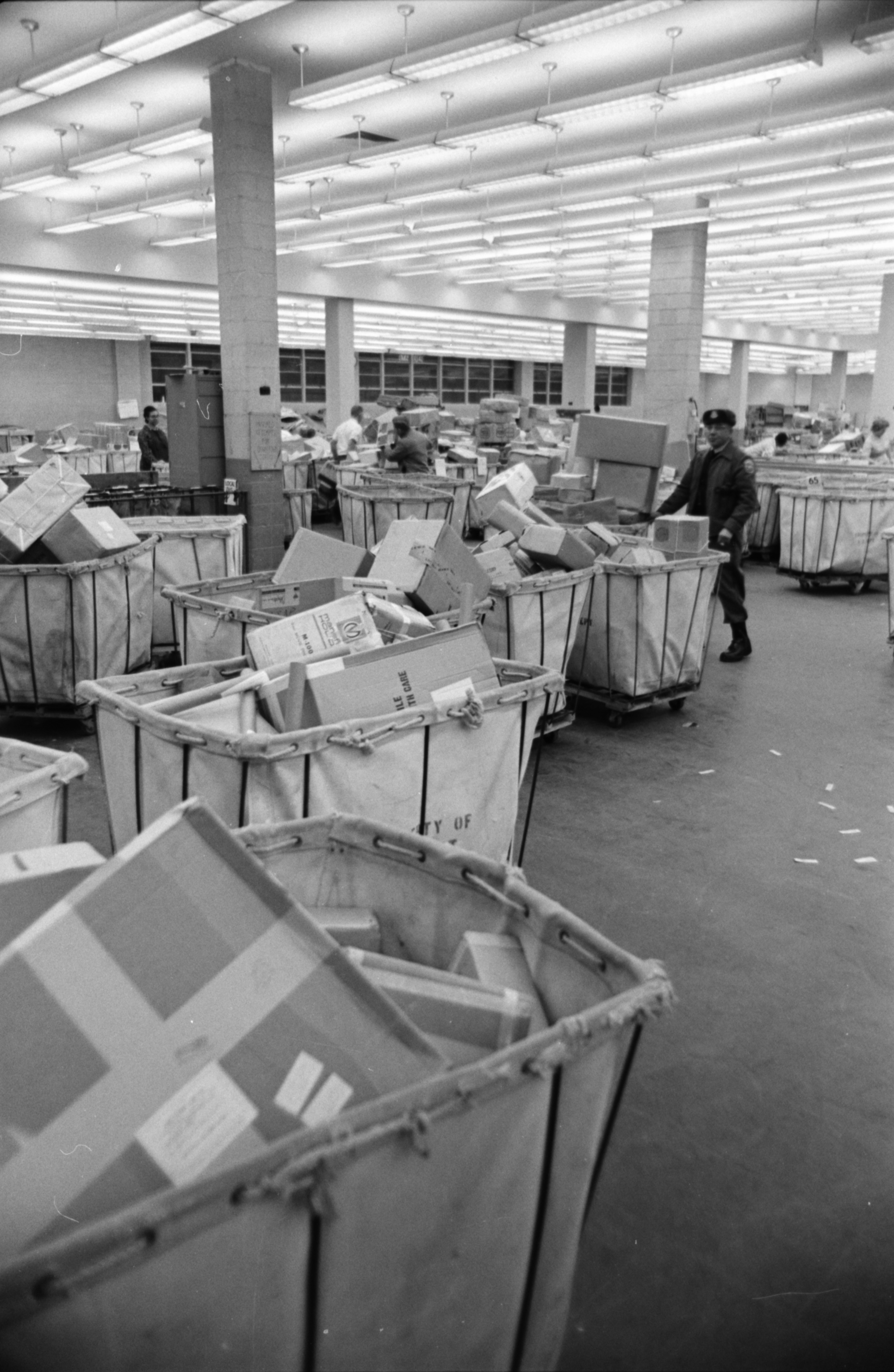 Hampers full of holiday mail at the W. Stadium Post Office, December 1966 image