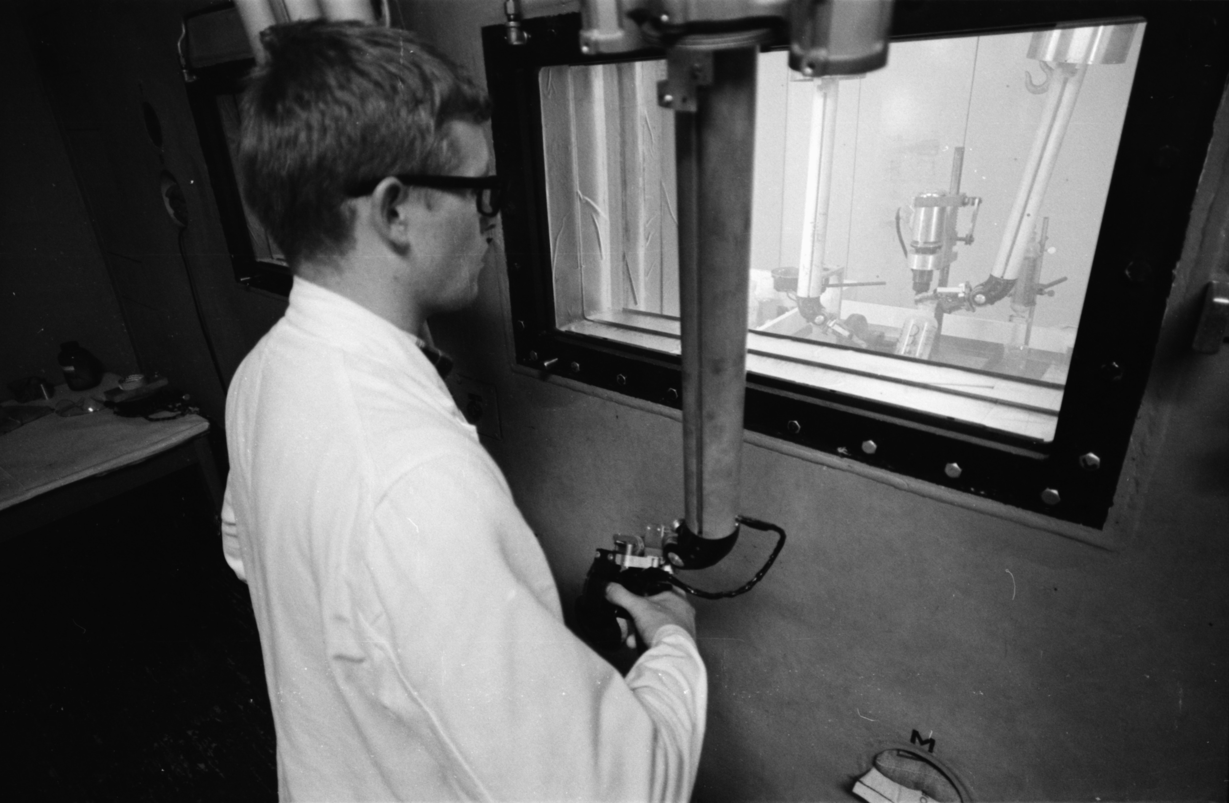 David Rawling works with the Ford Nuclear Reactor in the Phoenix Laboratory, North Campus, August 1968 image