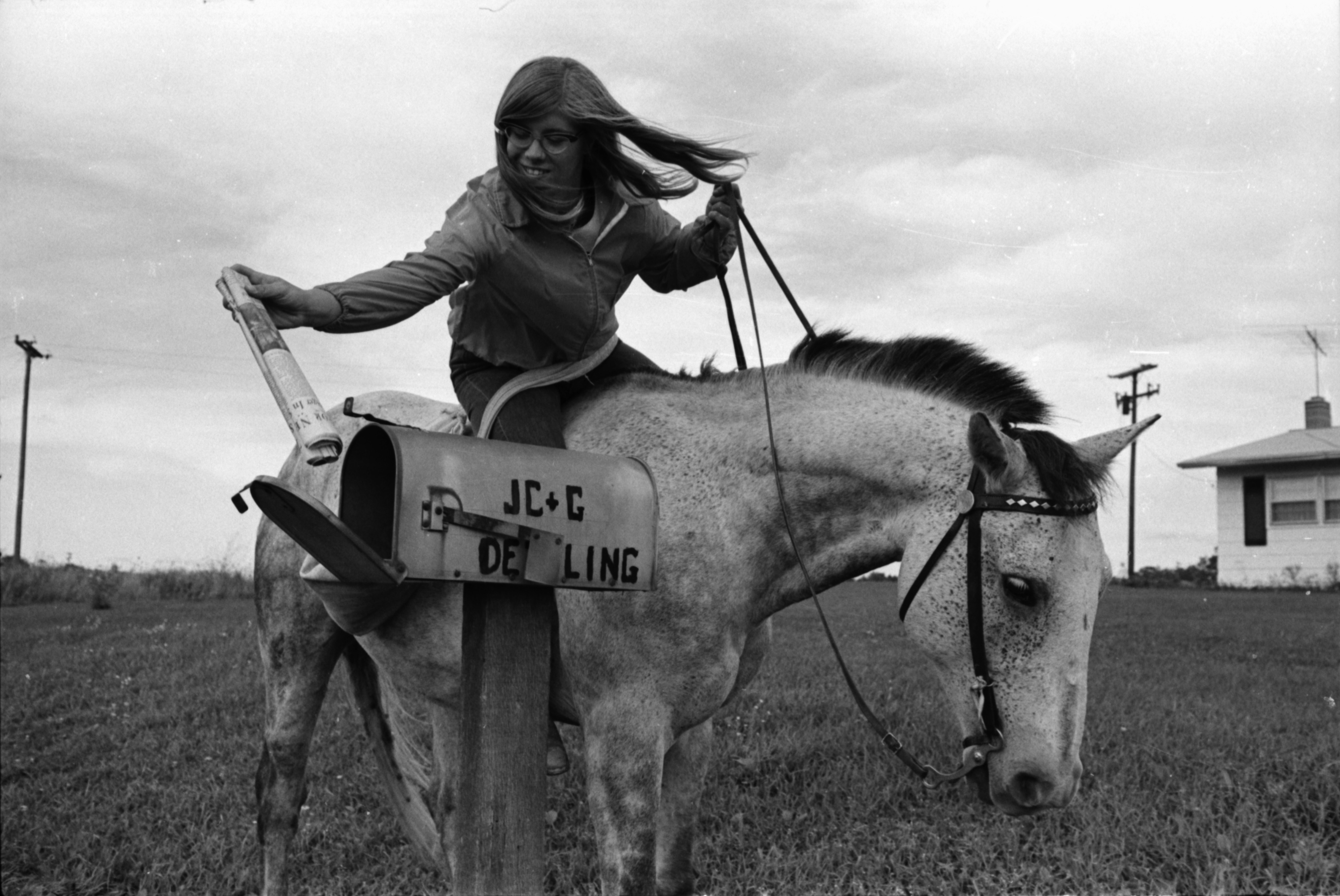 15-year-old Carol Boehler and Smokey deliver the Ann Arbor News in Freedom Township, October 1968 image