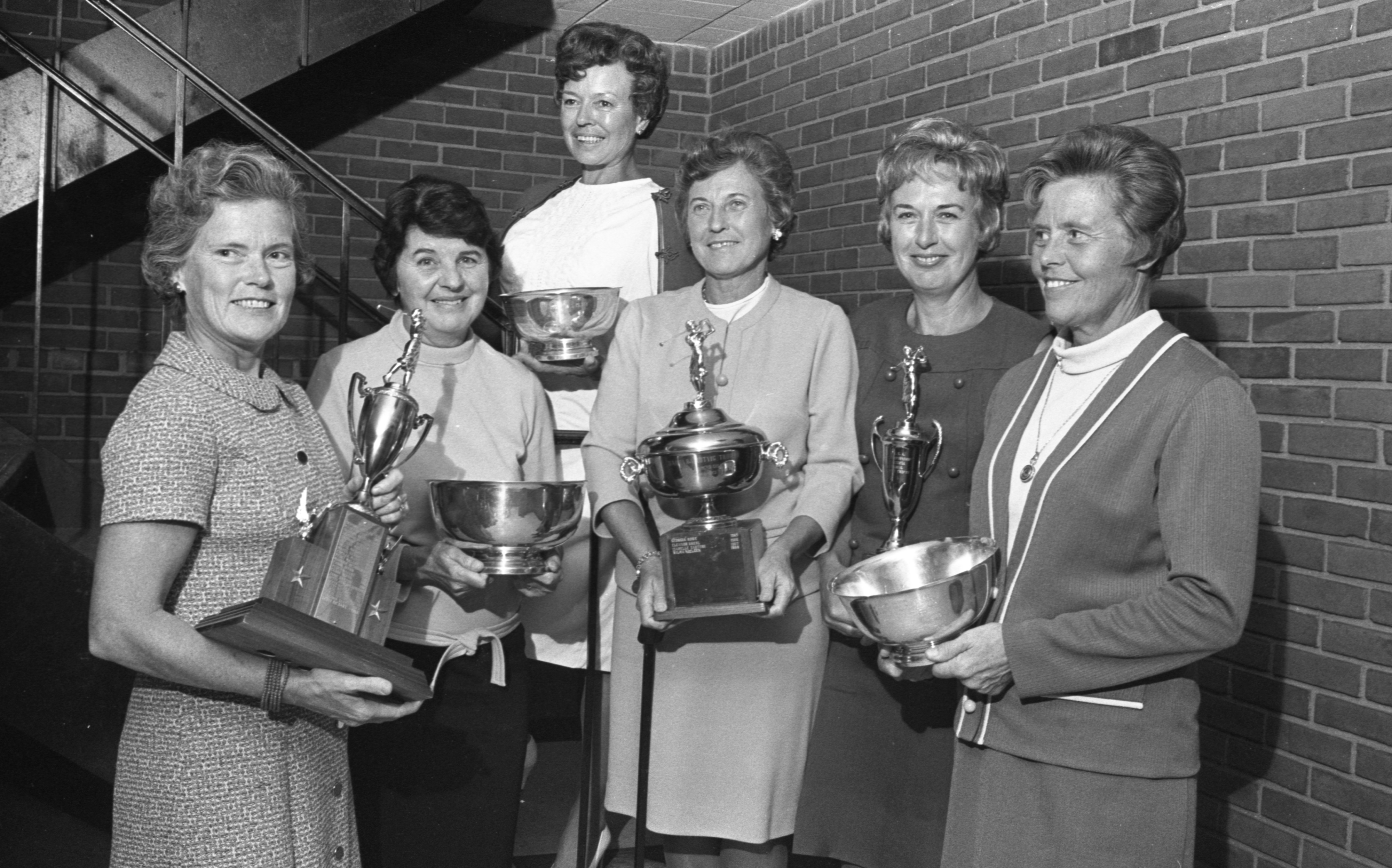 Ann Arbor Women's Golf Association Members Display Their 1968 Trophys At Fireside Lounge, September 1968 image