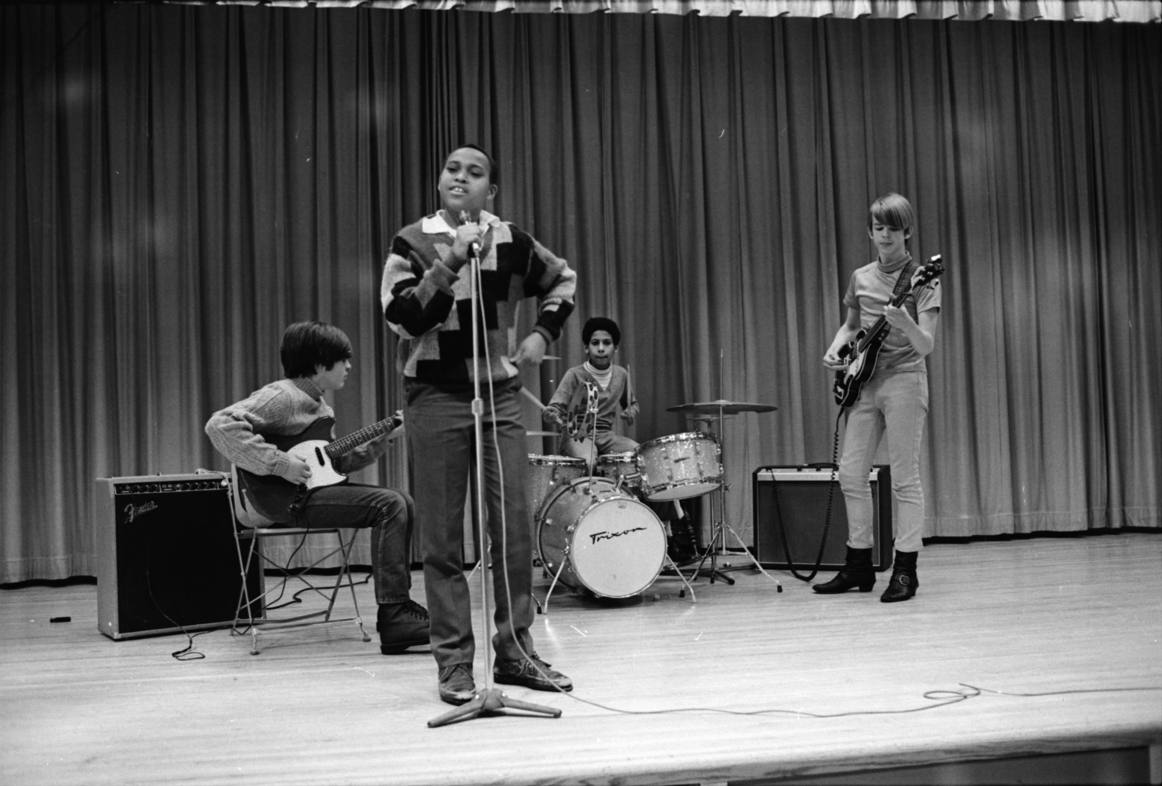 Mike Shaw, Matt Becker, Haywood Hall, and Tim Connor perform at Forsythe Junior High School's Talent Show, January 1969 image