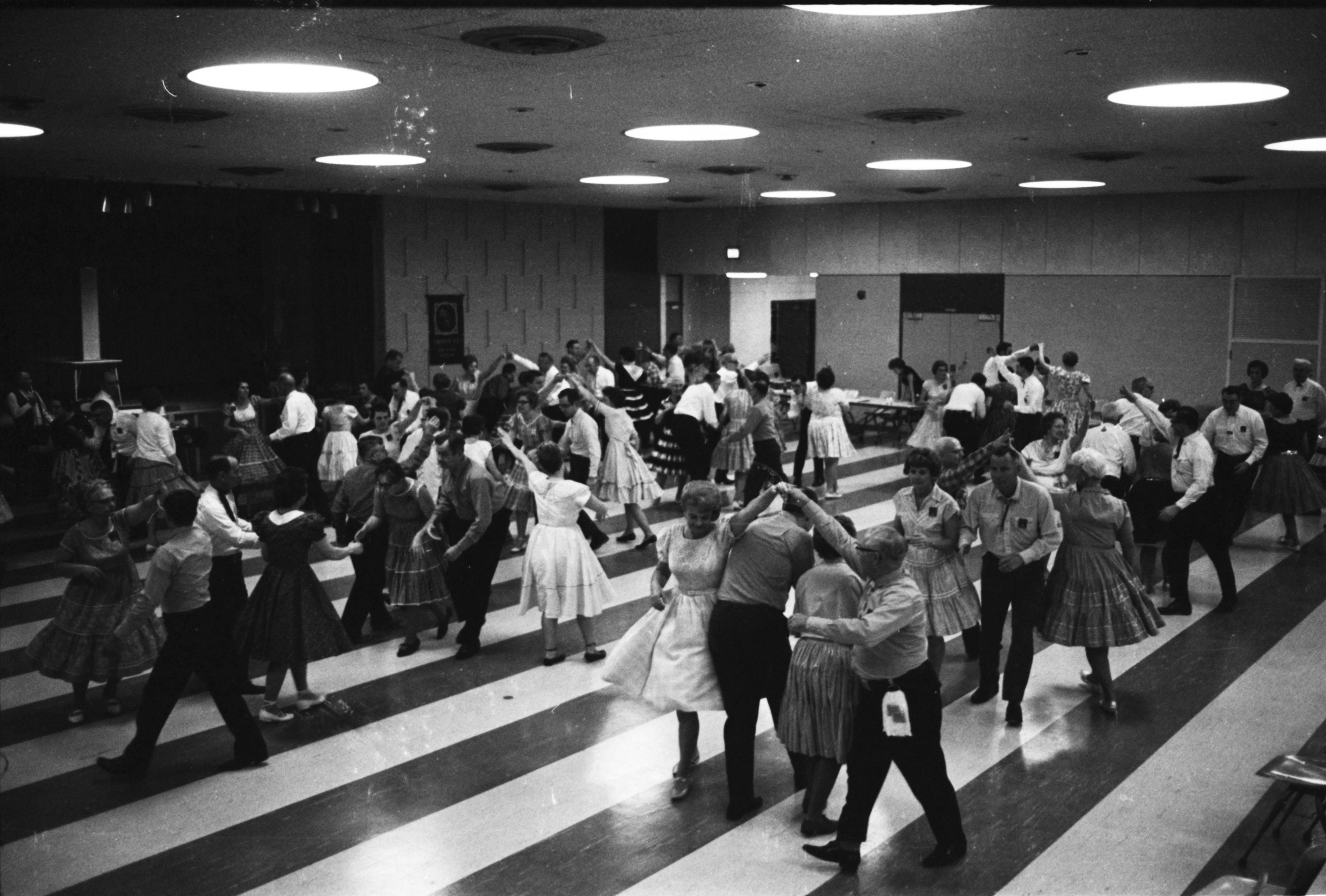 "The ""Swingin' A's"" advanced square dancing class in Forsythe Middle School gym, January 1969 image"