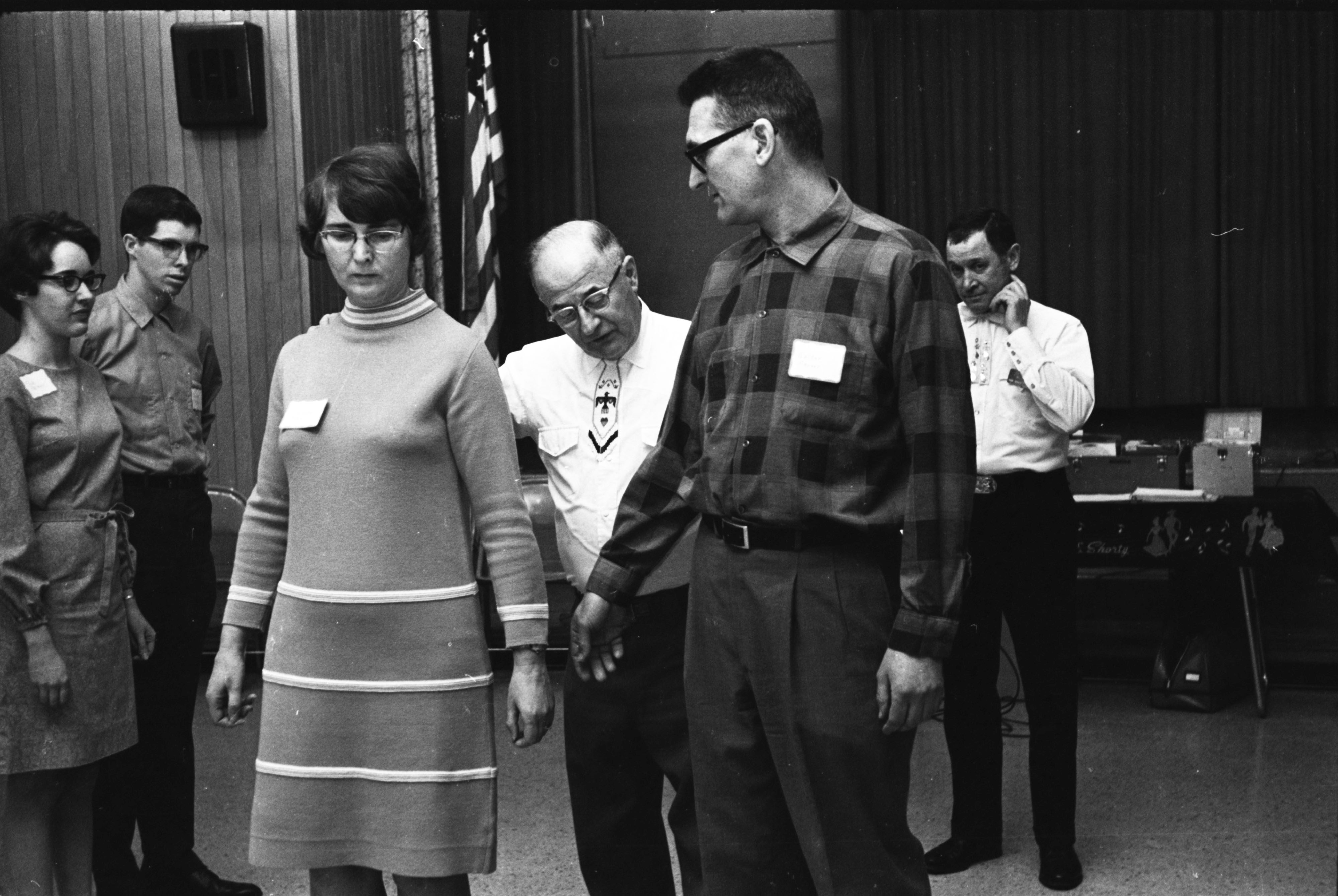 Caller-instructor Shorty Hoffmeyer explains a square dancing move, January 1969 image