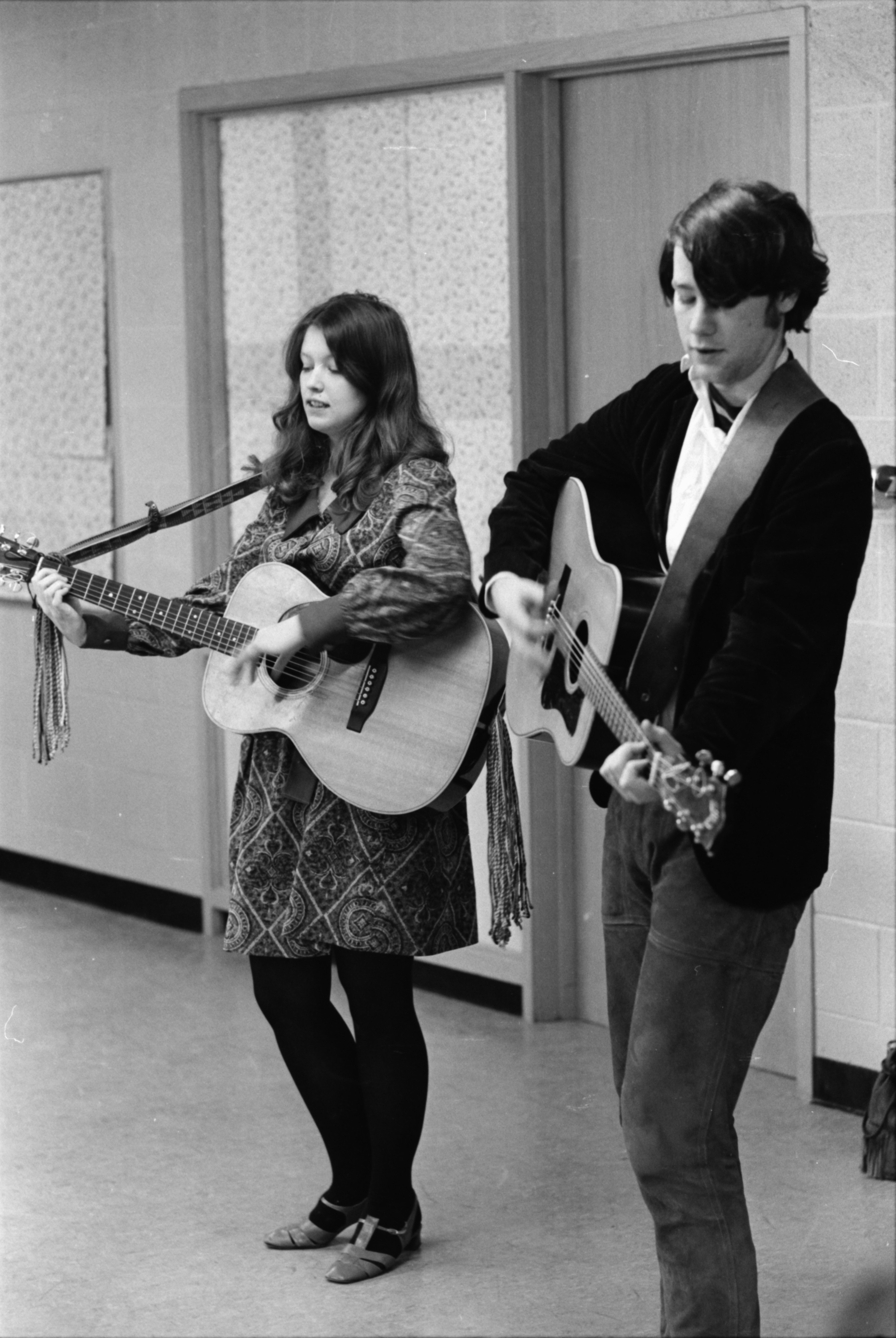 "Ann Arbor folk duo ""Christopher and Sara"" sing for PInckney High School students, February 1969 image"