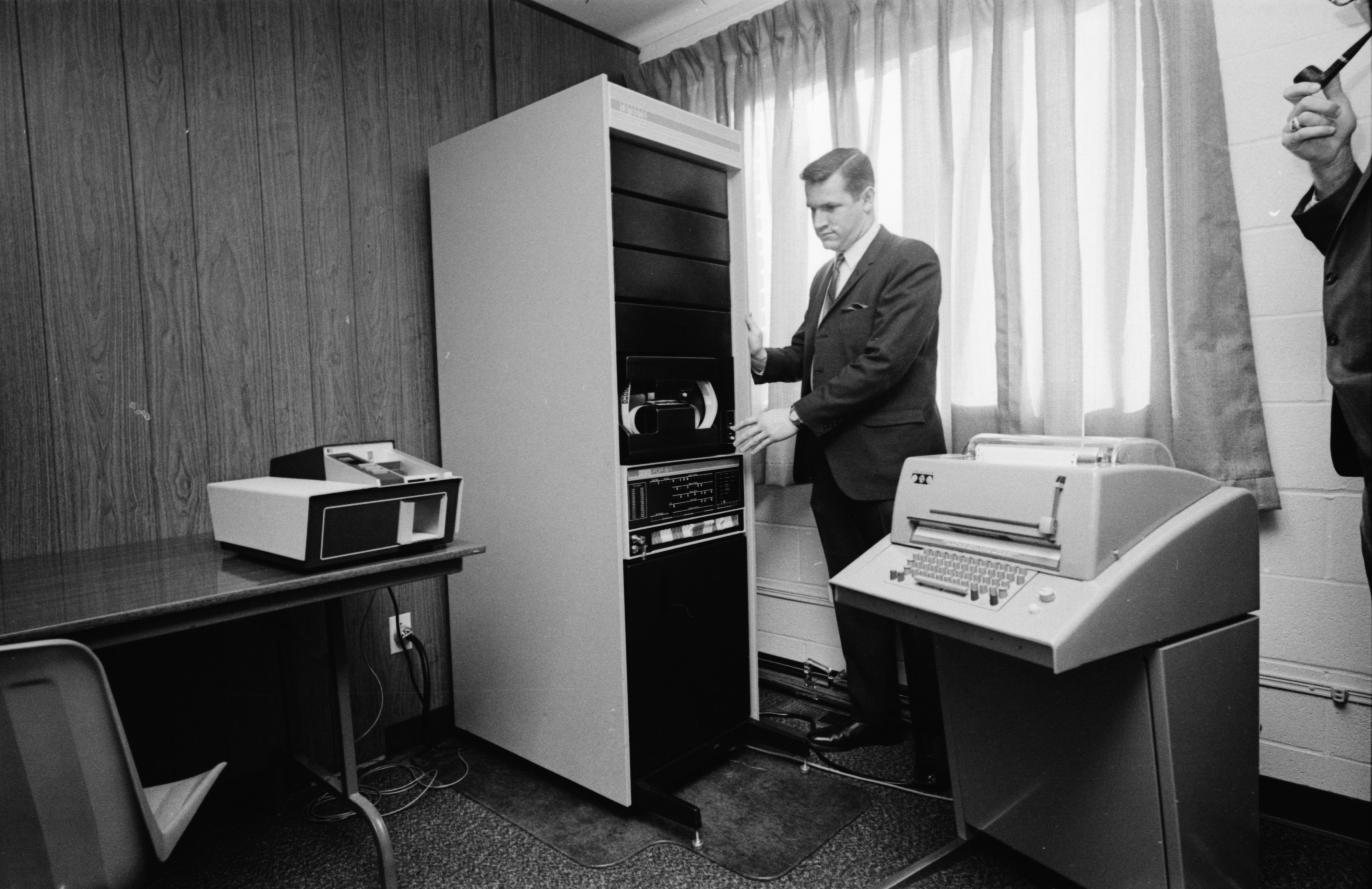 William C. Menke Poses With Computer, March 1969 image