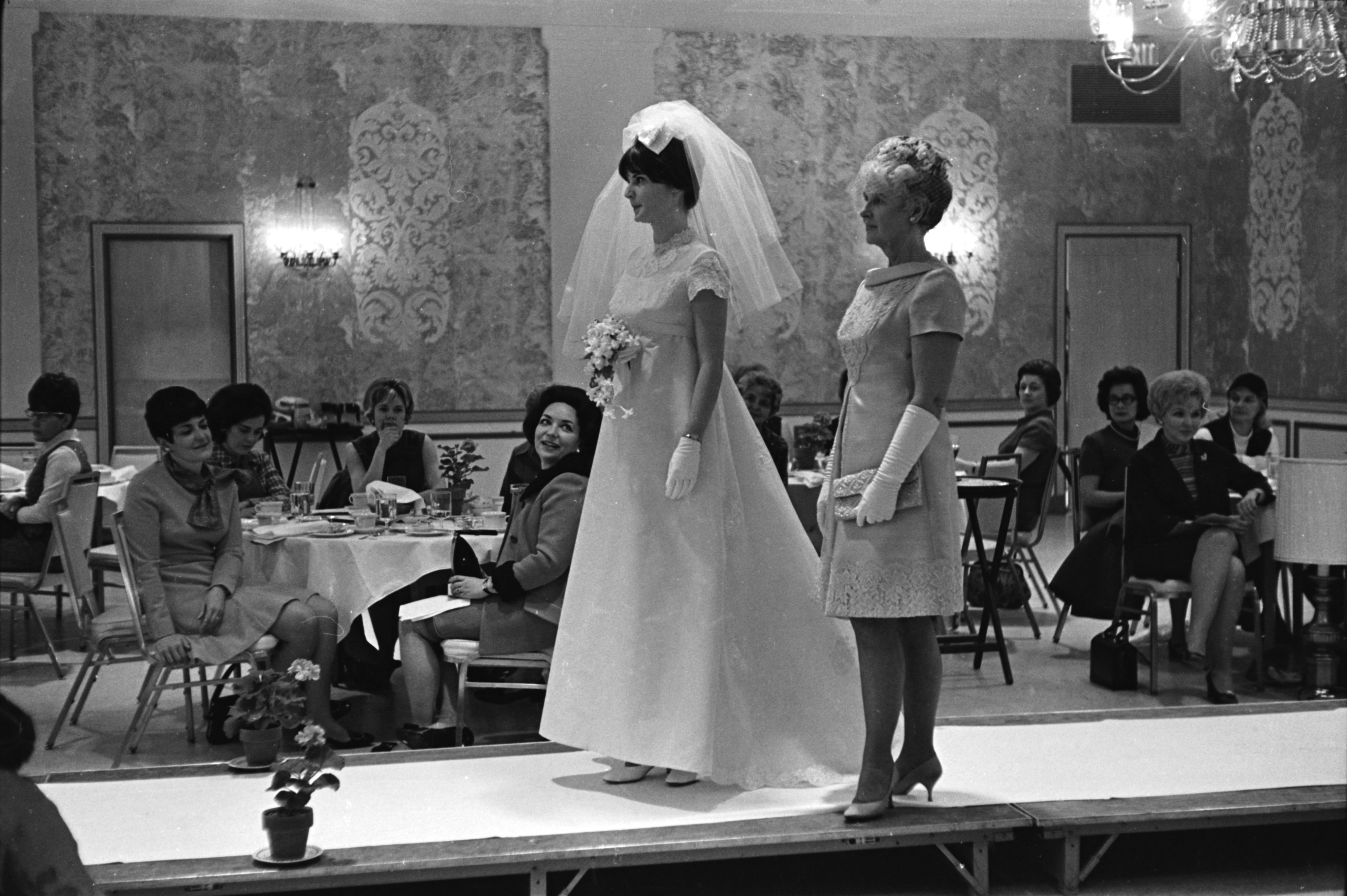 Mary Hoy models a wedding dress at the March of Dimes Fashion Show, February 1969 image