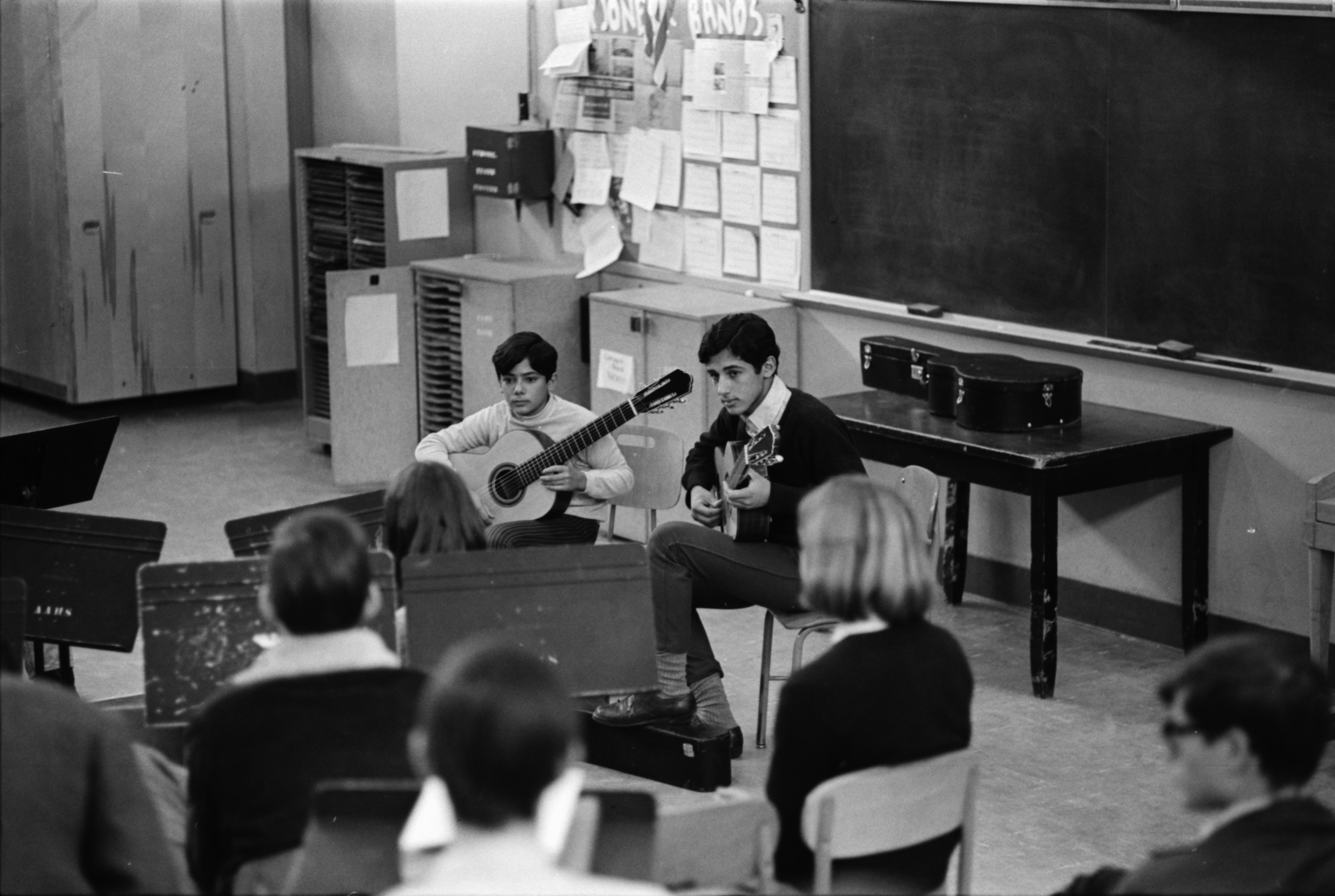 Odair and Sergio Assad, brothers from Rio de Janeiro, play classical guitar in Pioneer High School class, February 1969 image