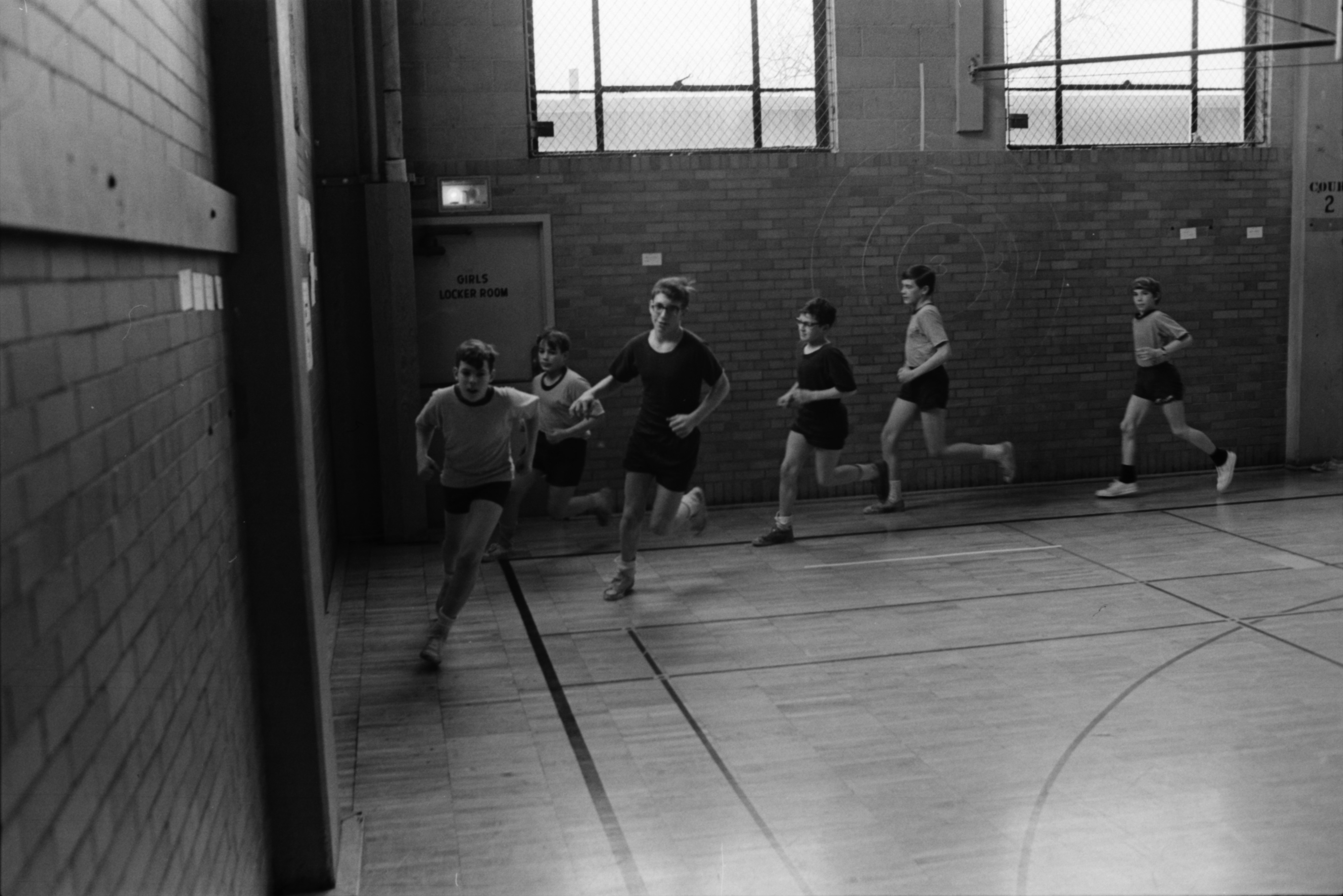 Slauson students running in gym, February 1969 image