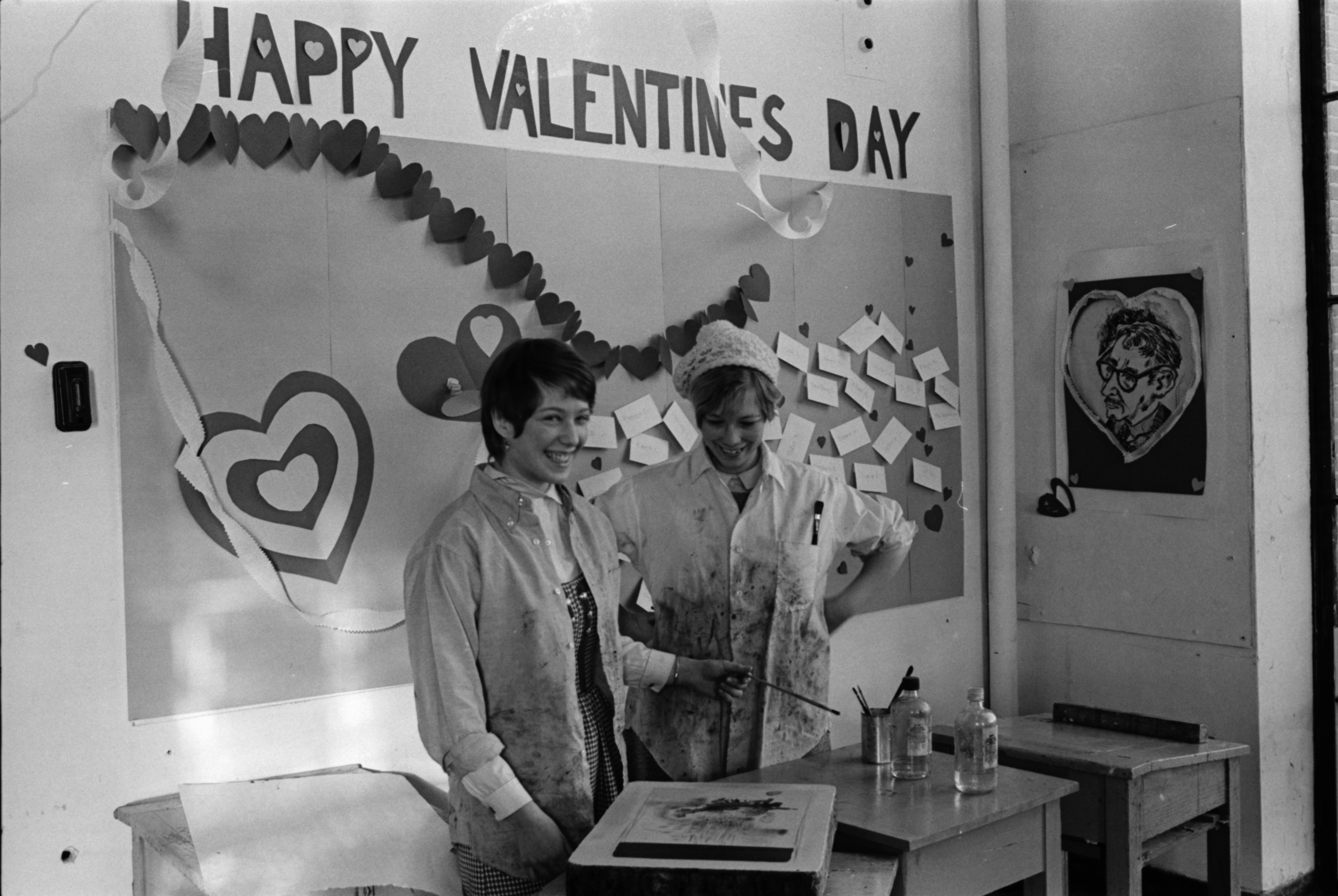 "U-M art students Sara Harwin and Carol Hanmum paint a classroom in the U-M Architecture and Design Building ""red"" in observance of Valentine's Day, February 1969 image"