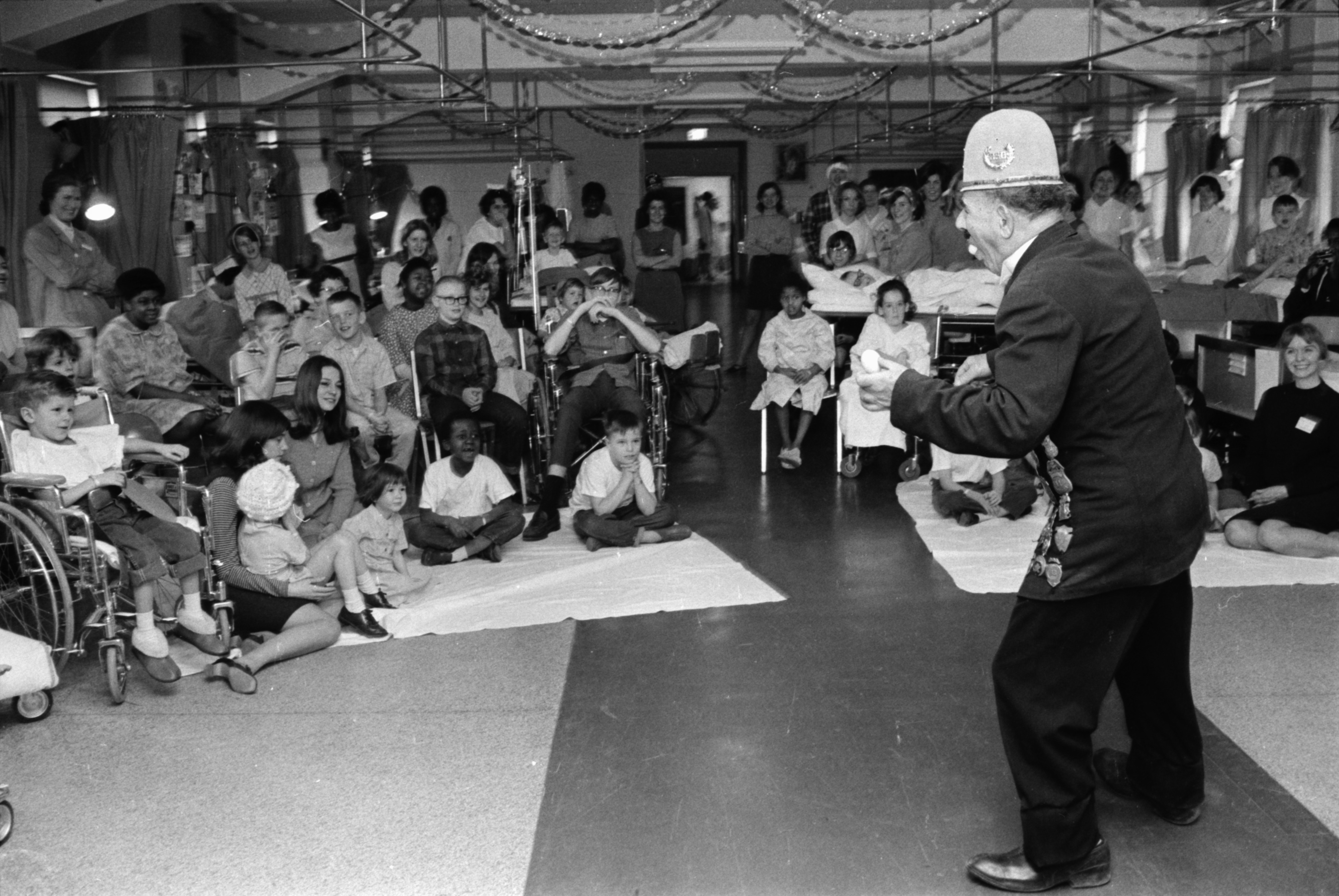 A clown from the Shrine Circus entertains kids at University Hospital, February 1969 image