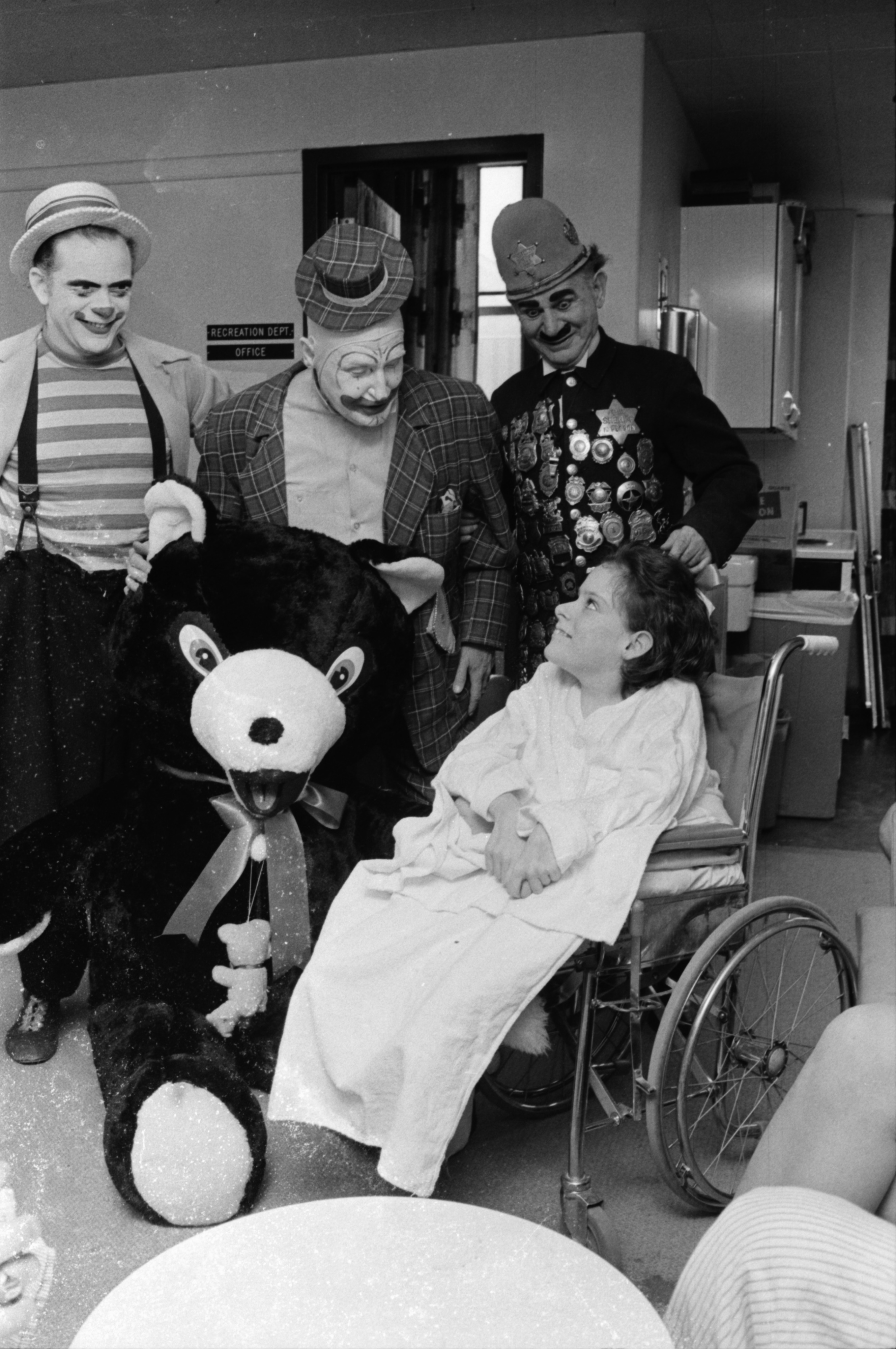 Clowns from the Shrine Circus visit Kay Schields at University Hospital, February 1969 image