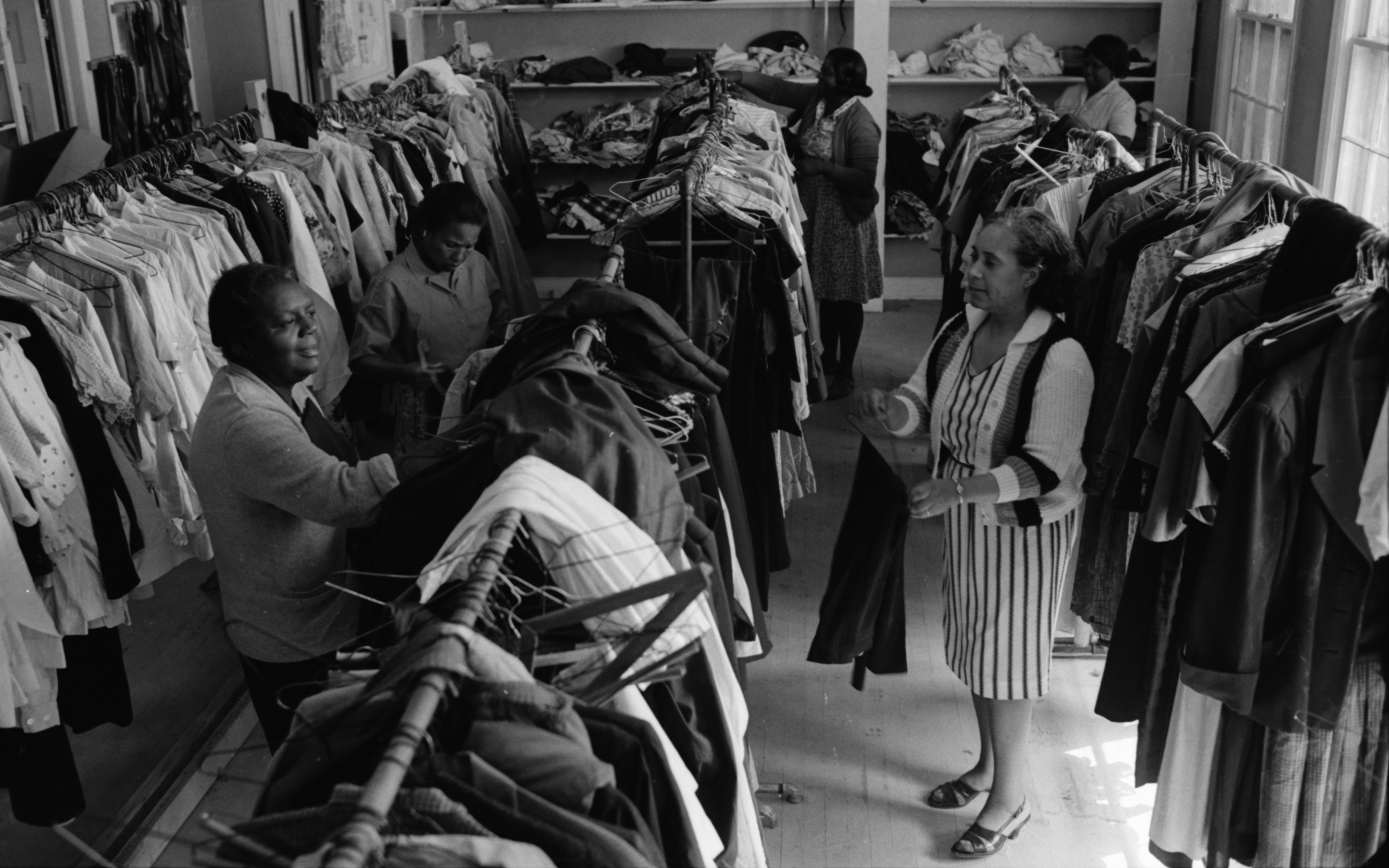 Volunteers help hang clothes at the Sumpter Clothing Center, June 1969 image