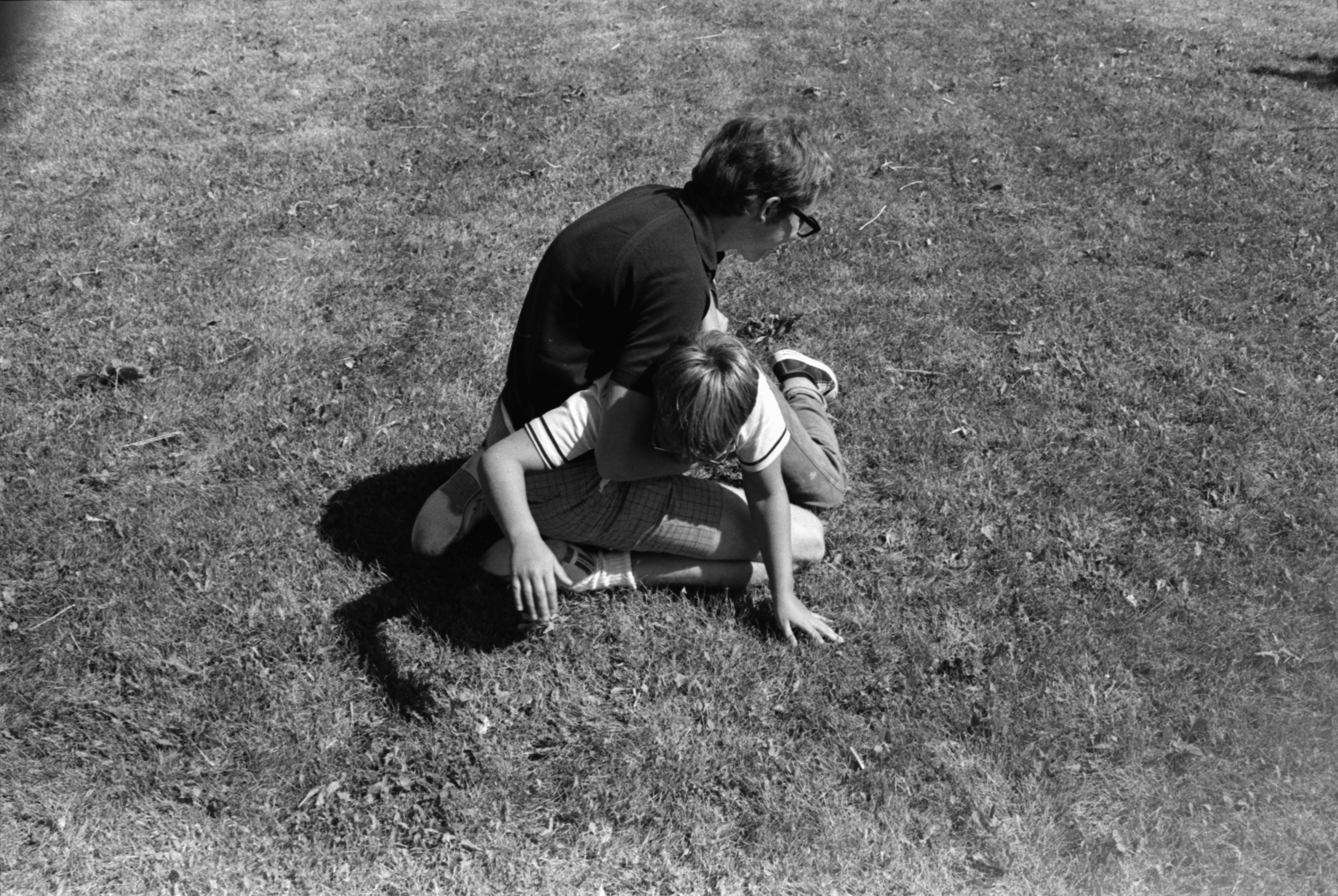 Counselor Carl Fredrickson holds one of the young boys attending Therapeutic Day Camp, July 1969 image