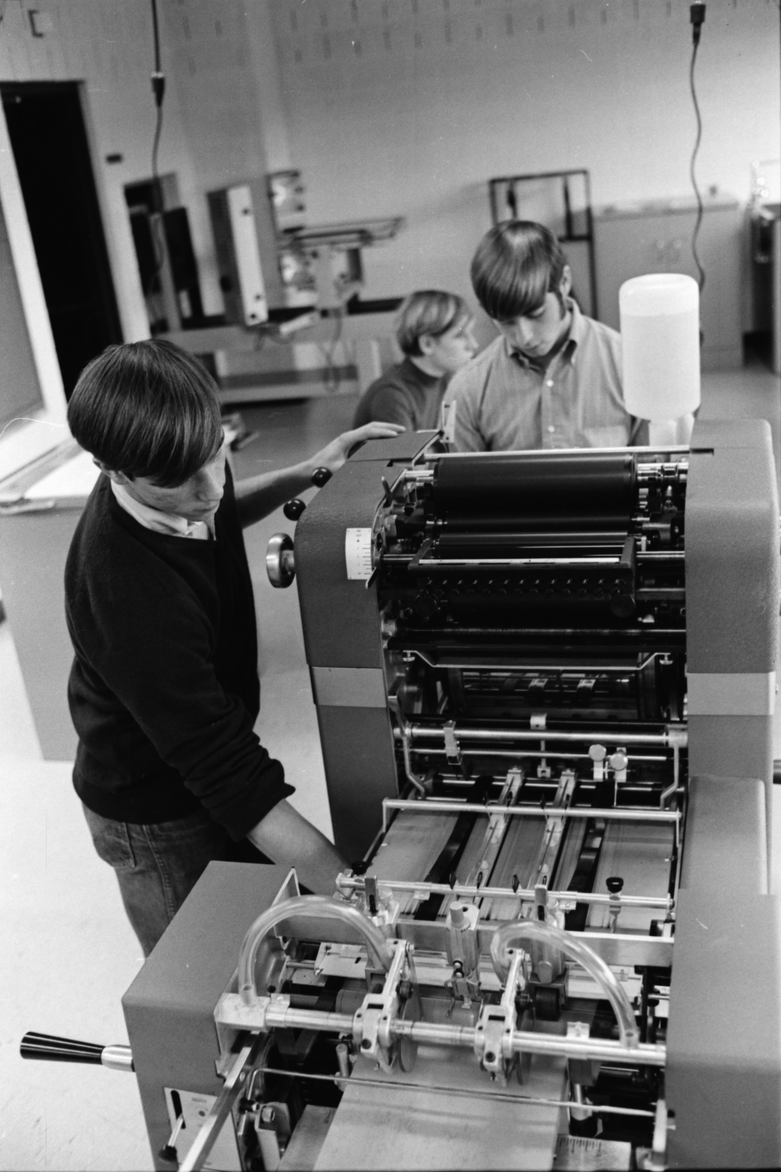 Mark Jewell and Scott Tremblay Trying Out New Print Machines at Huron High School, November 1969 image