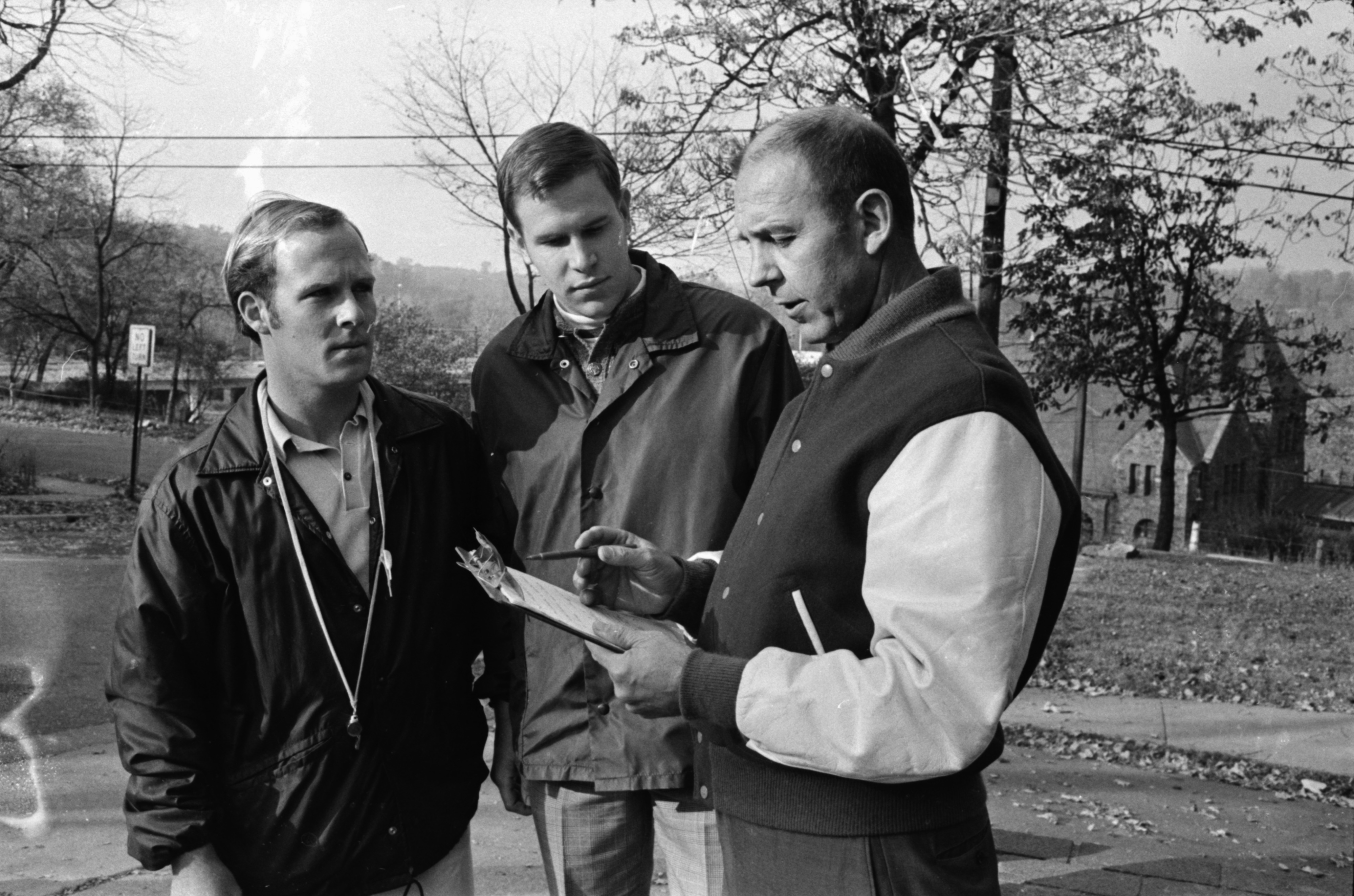 Coach and Assistant Coaches at St. Thomas the Apostle School: Making a Plan, November 1969 image