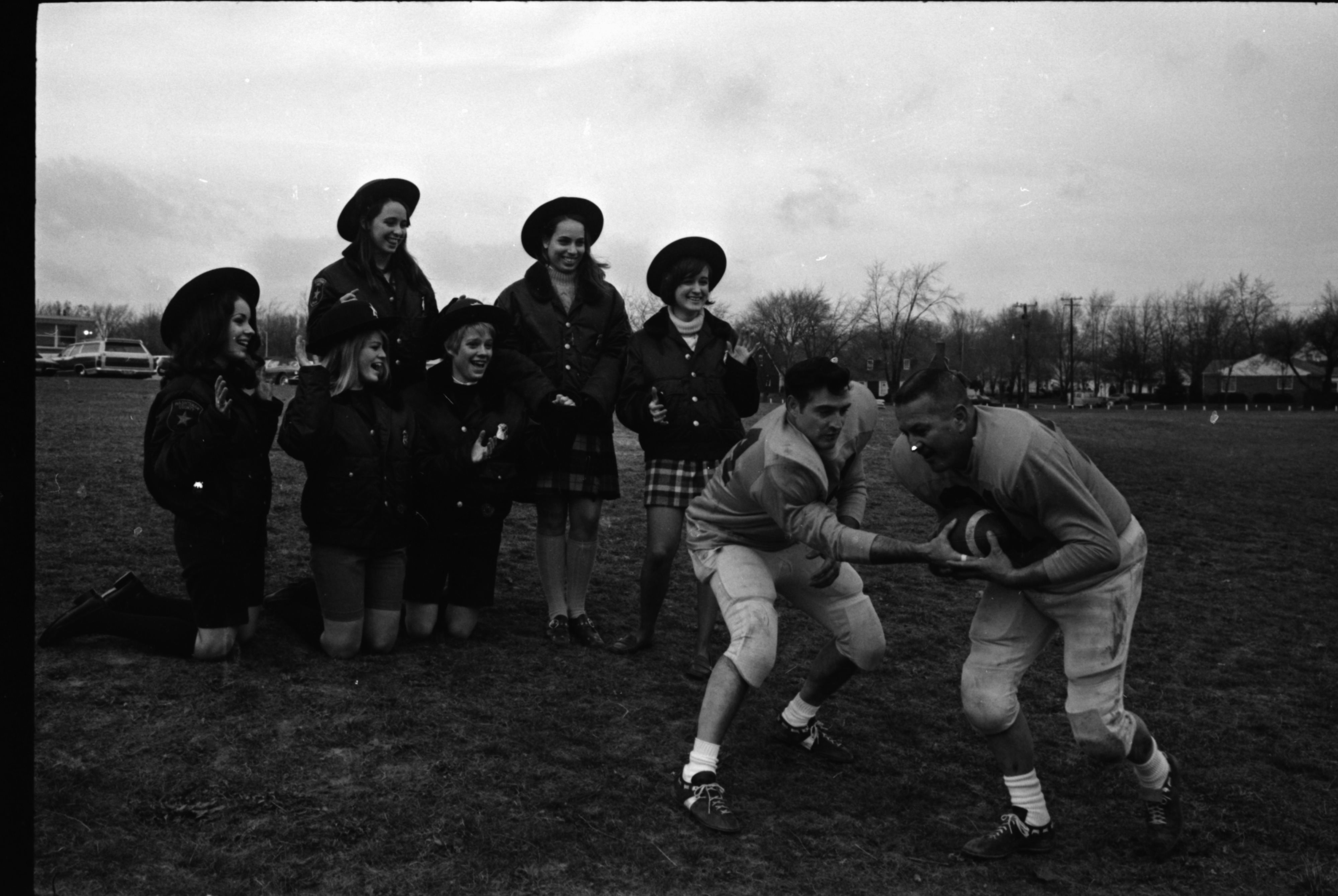 Girls Laugh While Watching Pigs Football Practice, December 1969 image