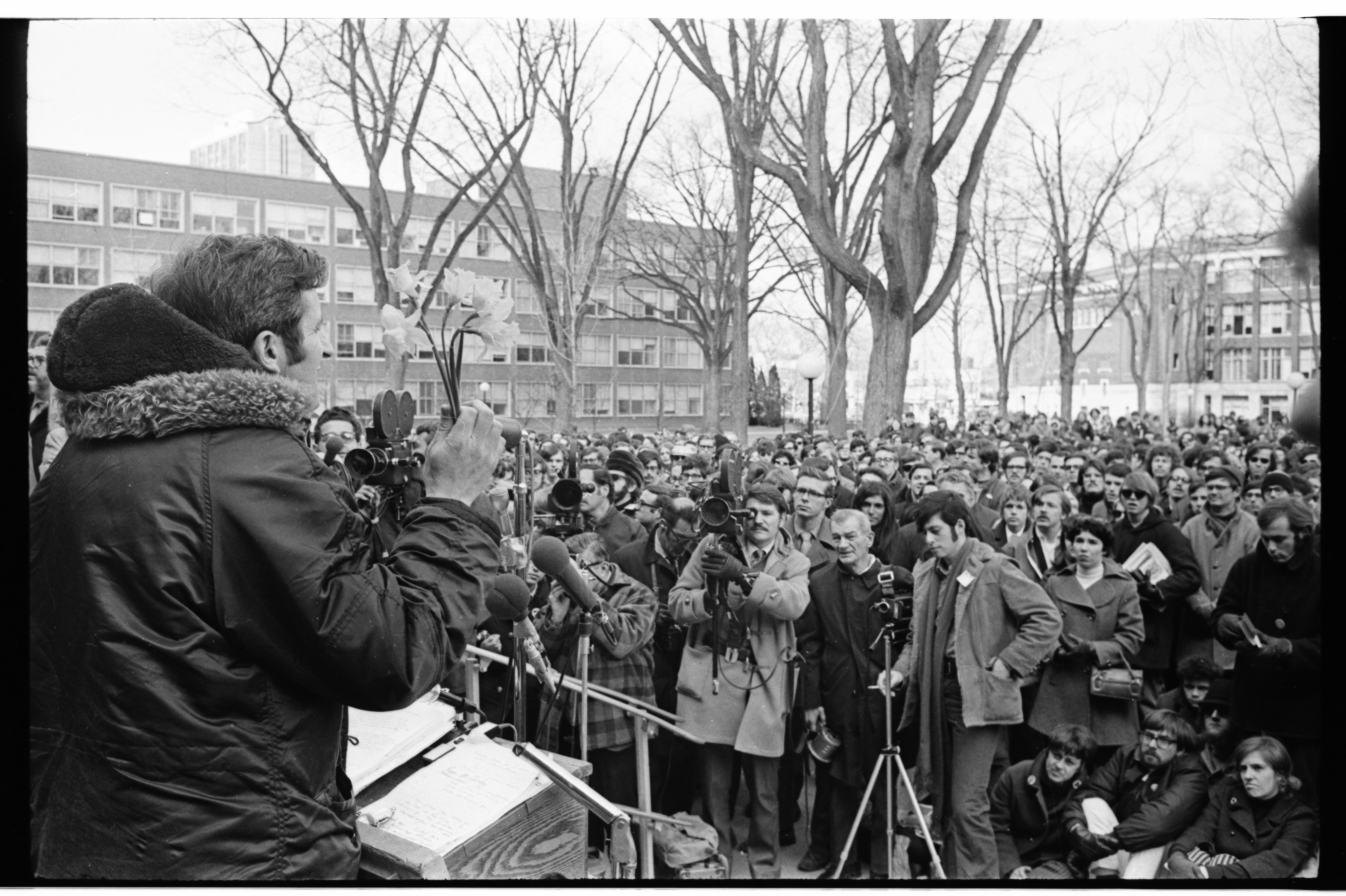 Ecologist Dr. Hugh Iltis Waves Flowers at ENACT Eco-Rally on University of Michigan Diag, March 1970 image