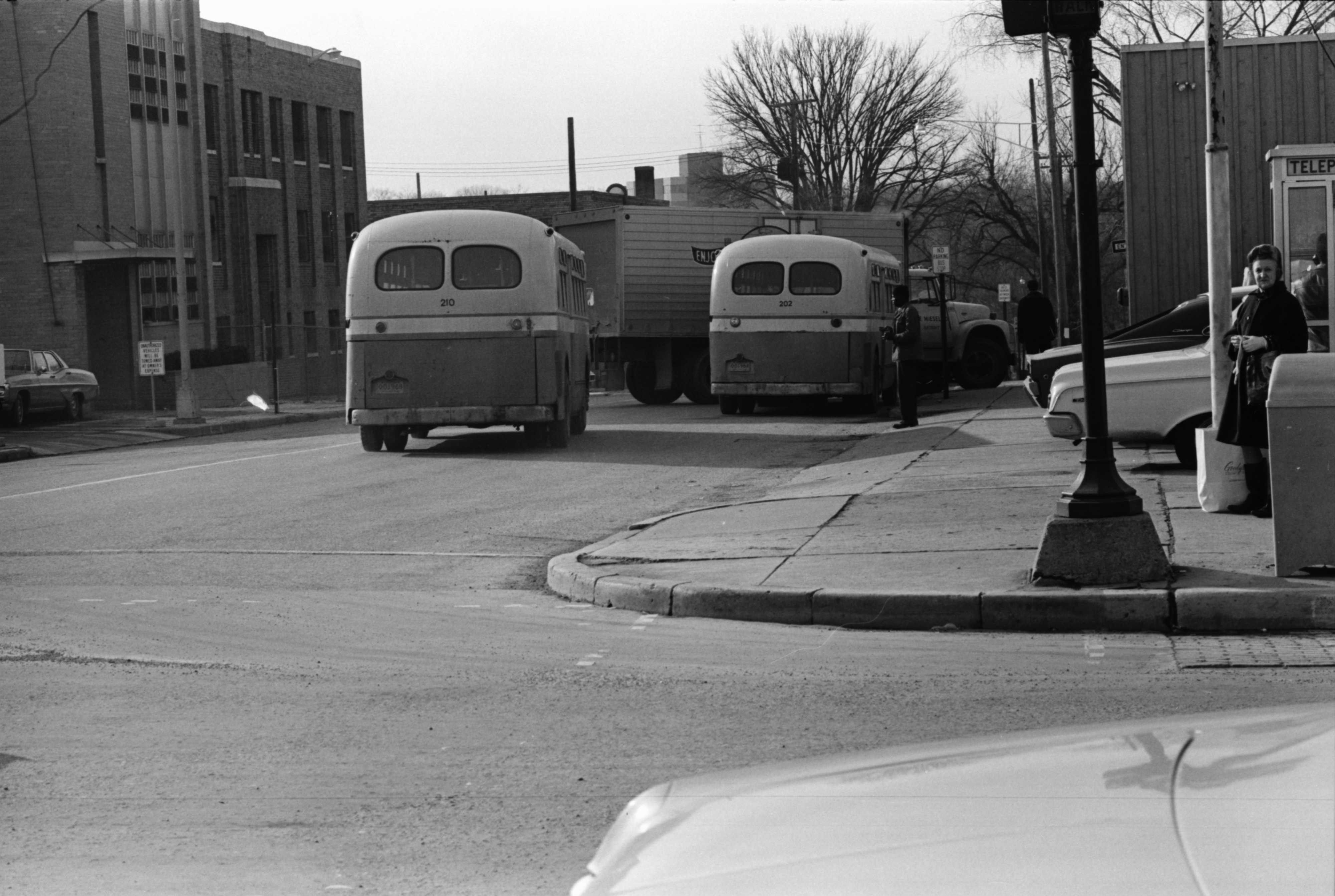 Two Ann Arbor City Transit buses on one of their last runs at Ann St. near Main, February 1969 image